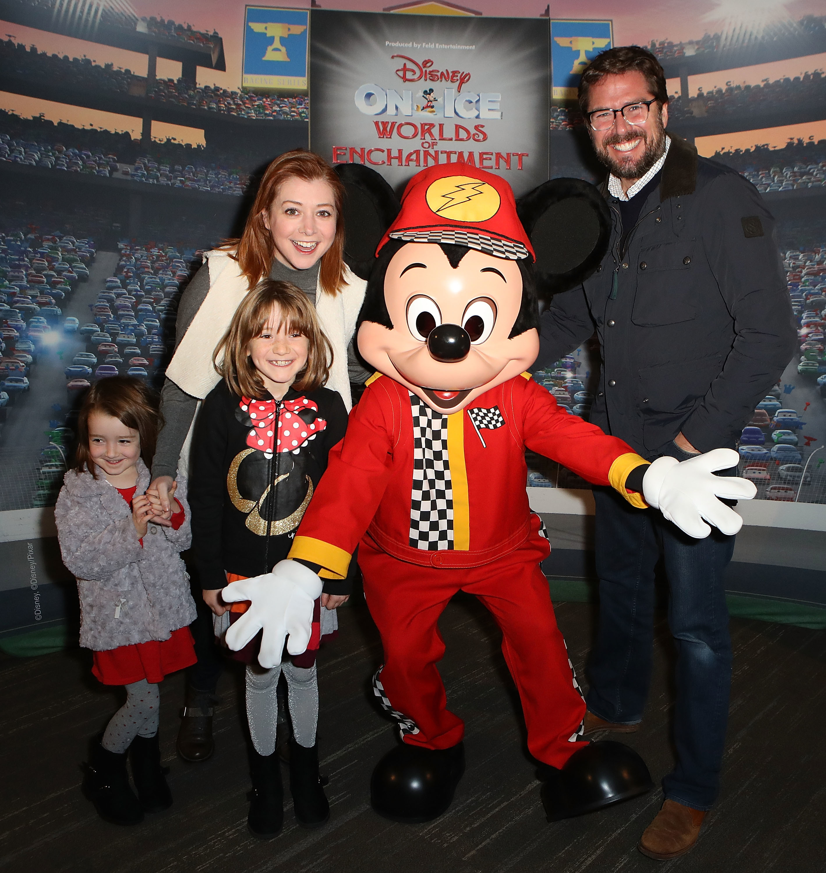 Alyson Hannigan, Alexis Denisof and their daughters, Keeva and Satyana, attend Disney On Ice presents Worlds of Enchantment at Staples Center in Los Angeles on Dec. 17, 2016.