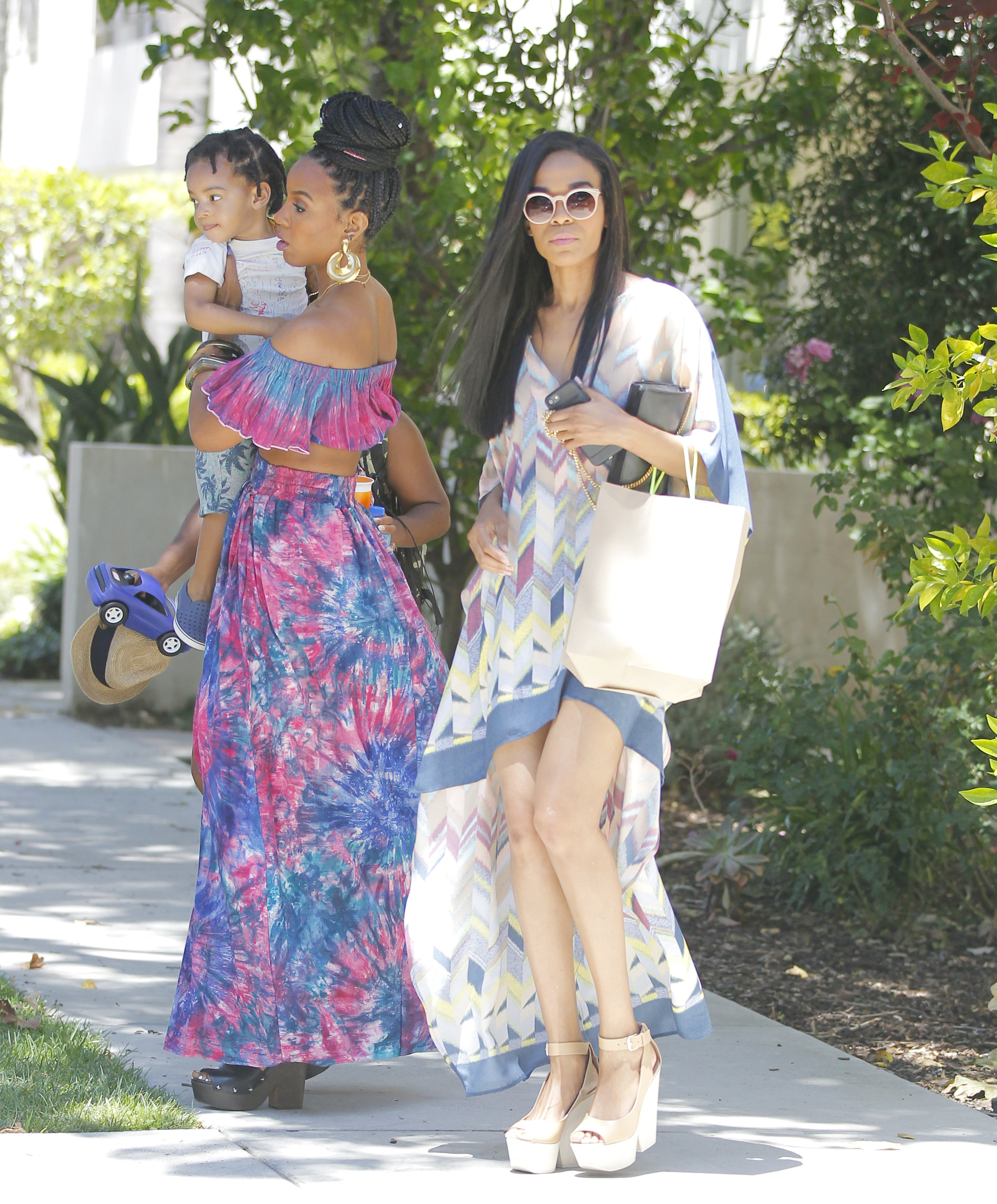 Kelly Rowland, son Titan Witherspoon and Michelle Williams leave Beyonce and Jay Z's baby shower in Los Angeles on May 20, 2017.