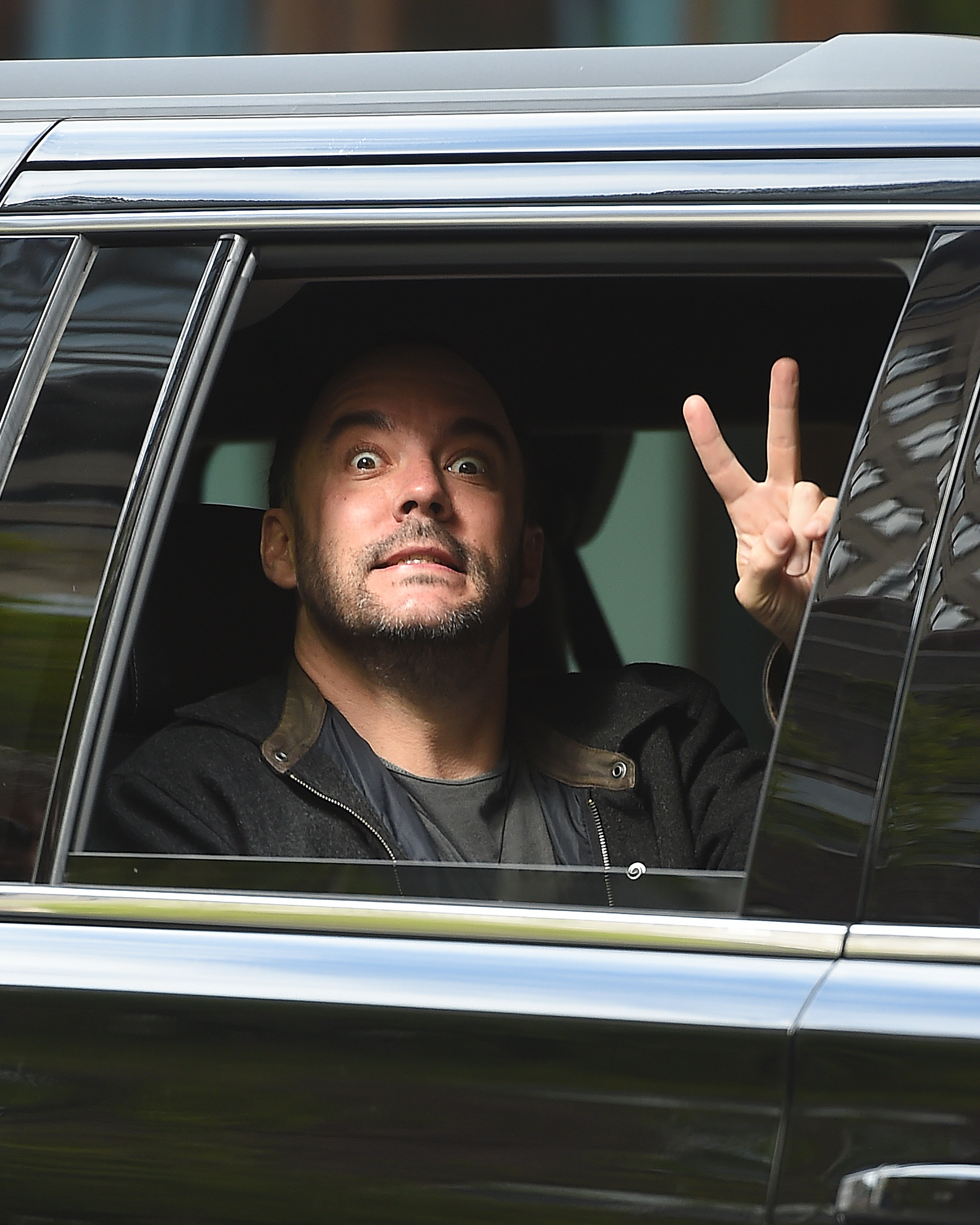 Dave Matthews flashes the peace sign in New York City on May 9, 2017.