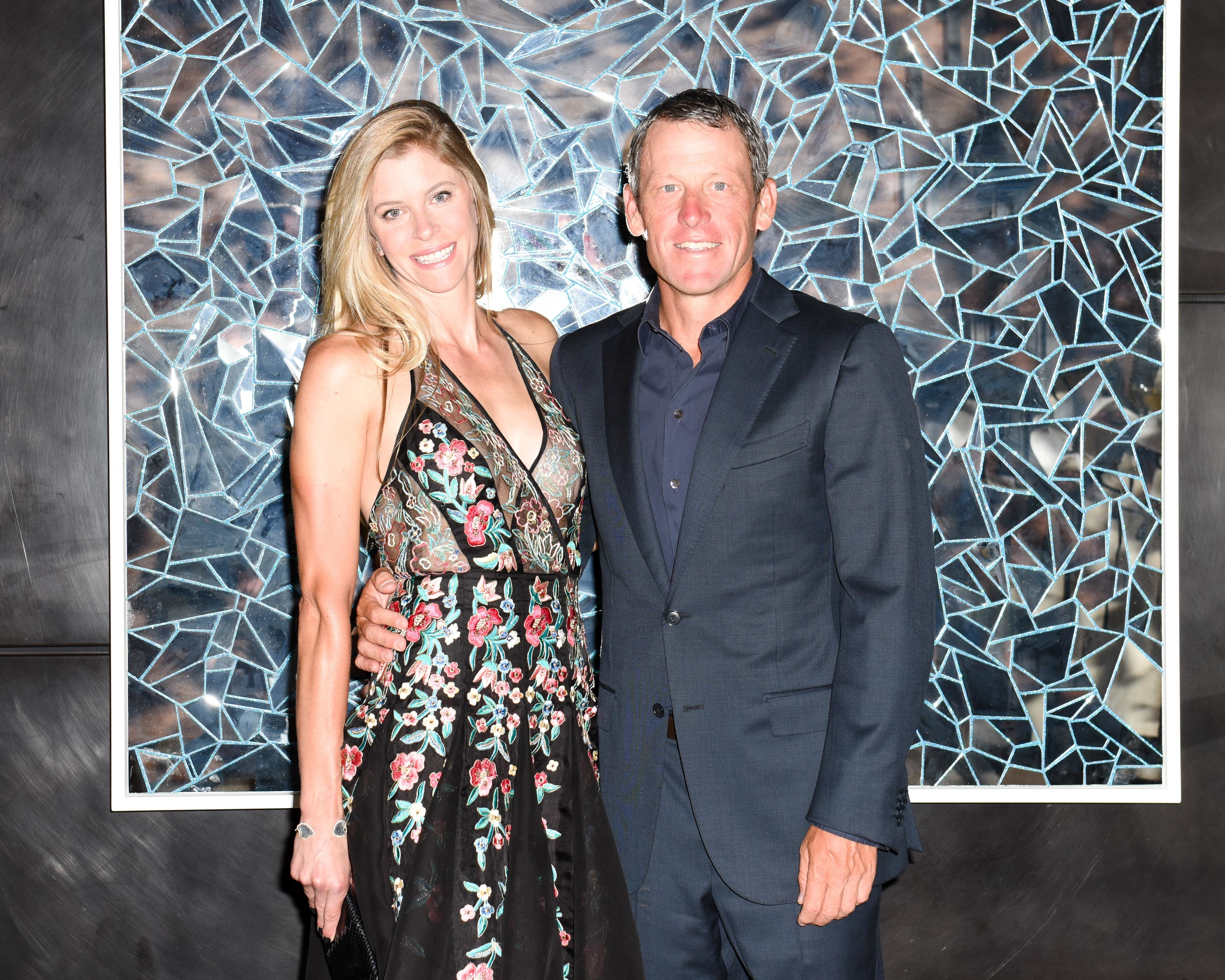 Anna Hansen and  Lance Armstrong at the Aspen Art Museum Wine Crush in Aspen, Colorado on Aug. 3, 2016.