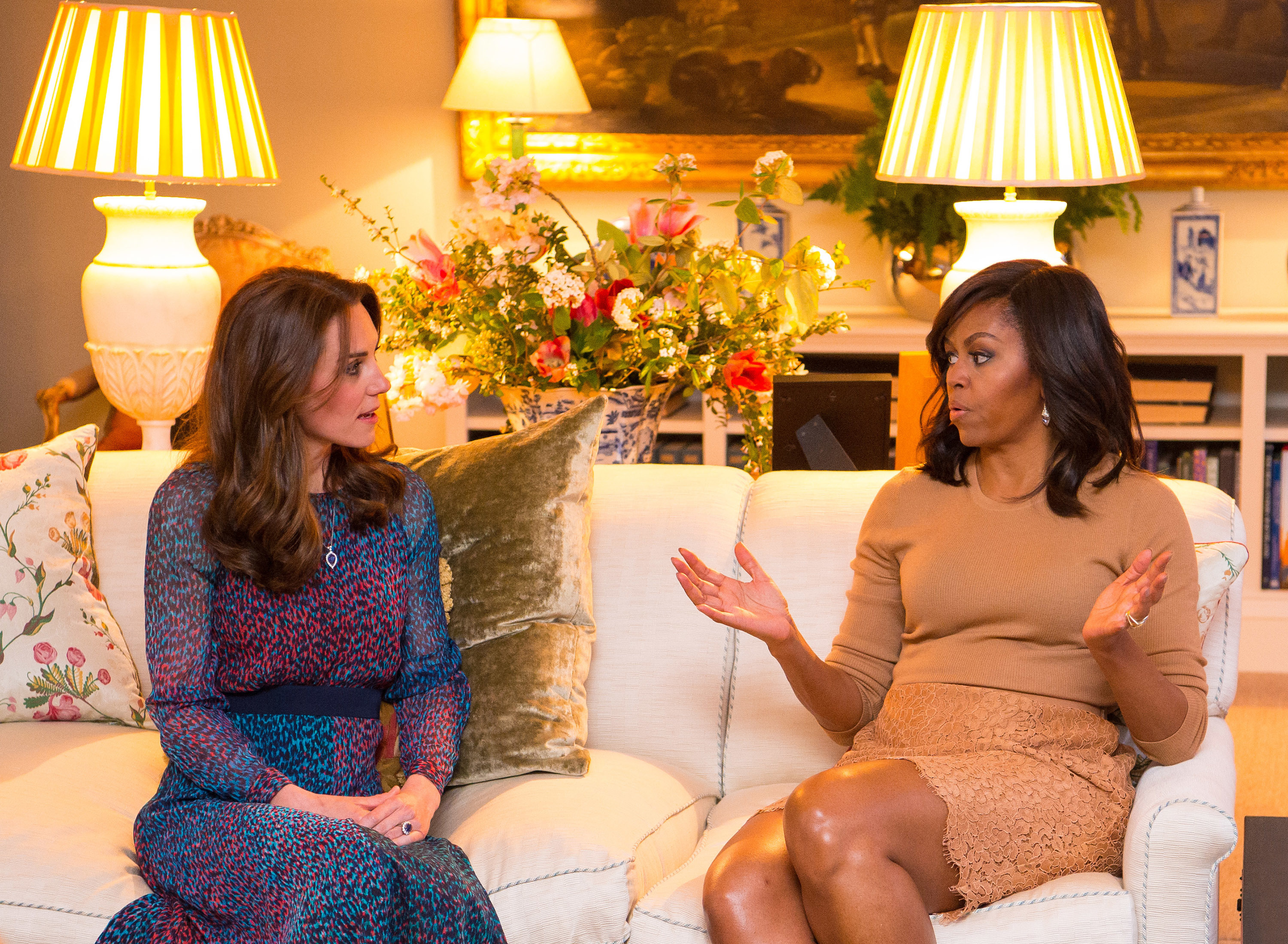 Duchess Kate and Michelle Obama speak at a state dinner at Kensington Palace in  London on April 22, 2016.
