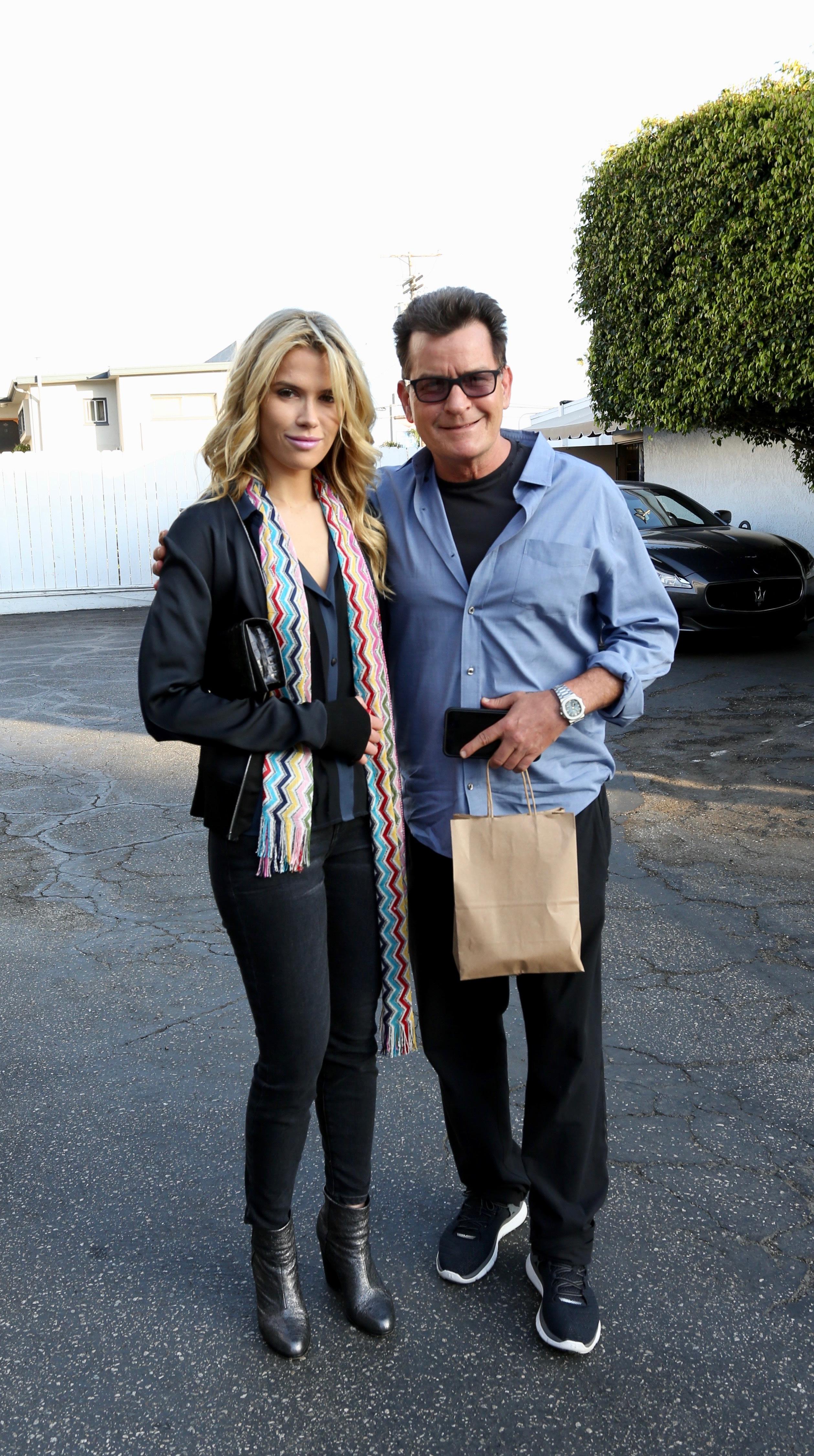 "Charlie Sheen leaves Giorgio Baldi restaurant in Santa Monica, California, with girlfriend Julia ""Jules"" Stambler on June 1, 2017."