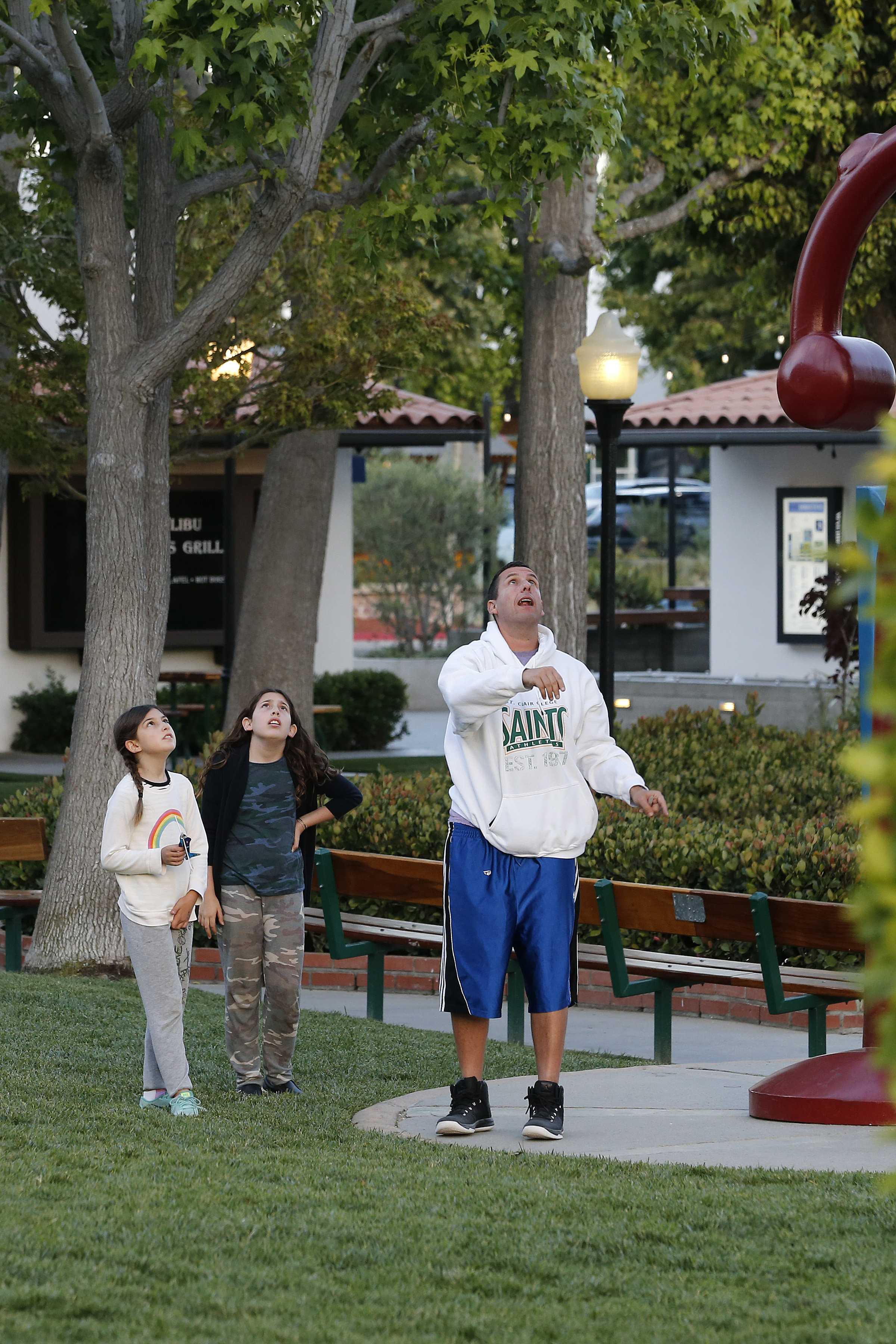 Adam Sandler showed his daughters how to fly a toy airplane in Malibu on May 29, 2017.