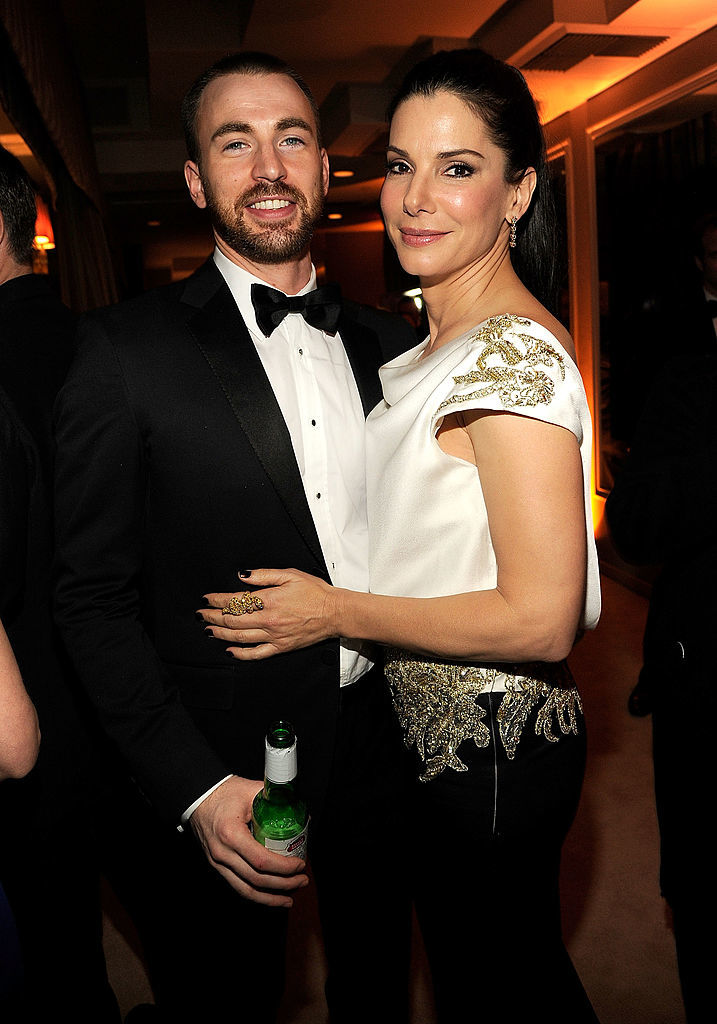 Chris Evans and Sandra Bullock attend the 2012 Vanity Fair Oscar Party Hosted by Graydon Carter at Sunset Tower in Los Angeles on Feb. 26, 2012.