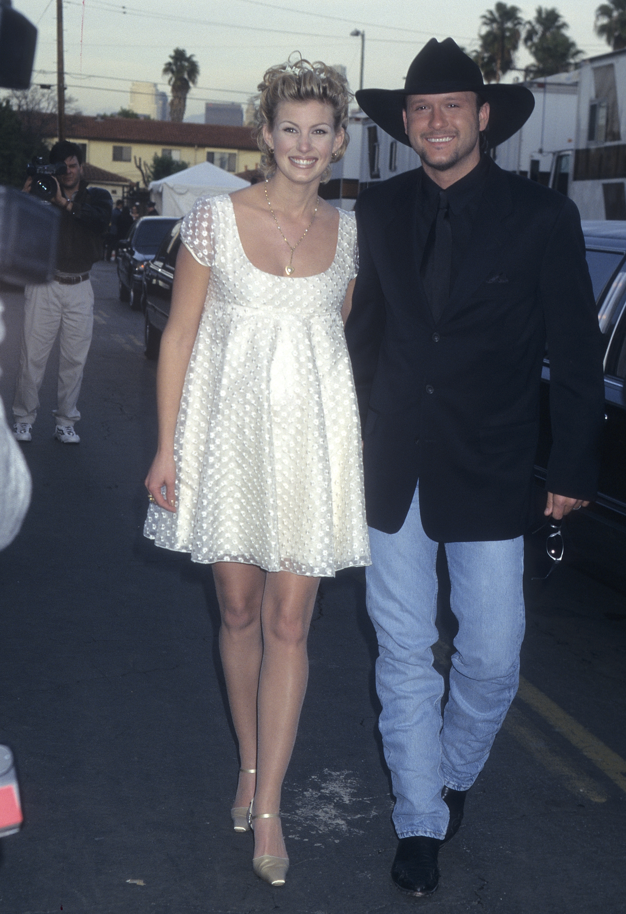 Pregnant Faith Hill and husband Tim McGraw attend the 24th Annual American Music Awards at the Shrine Auditorium in Los Angeles on Jan. 27, 1997.