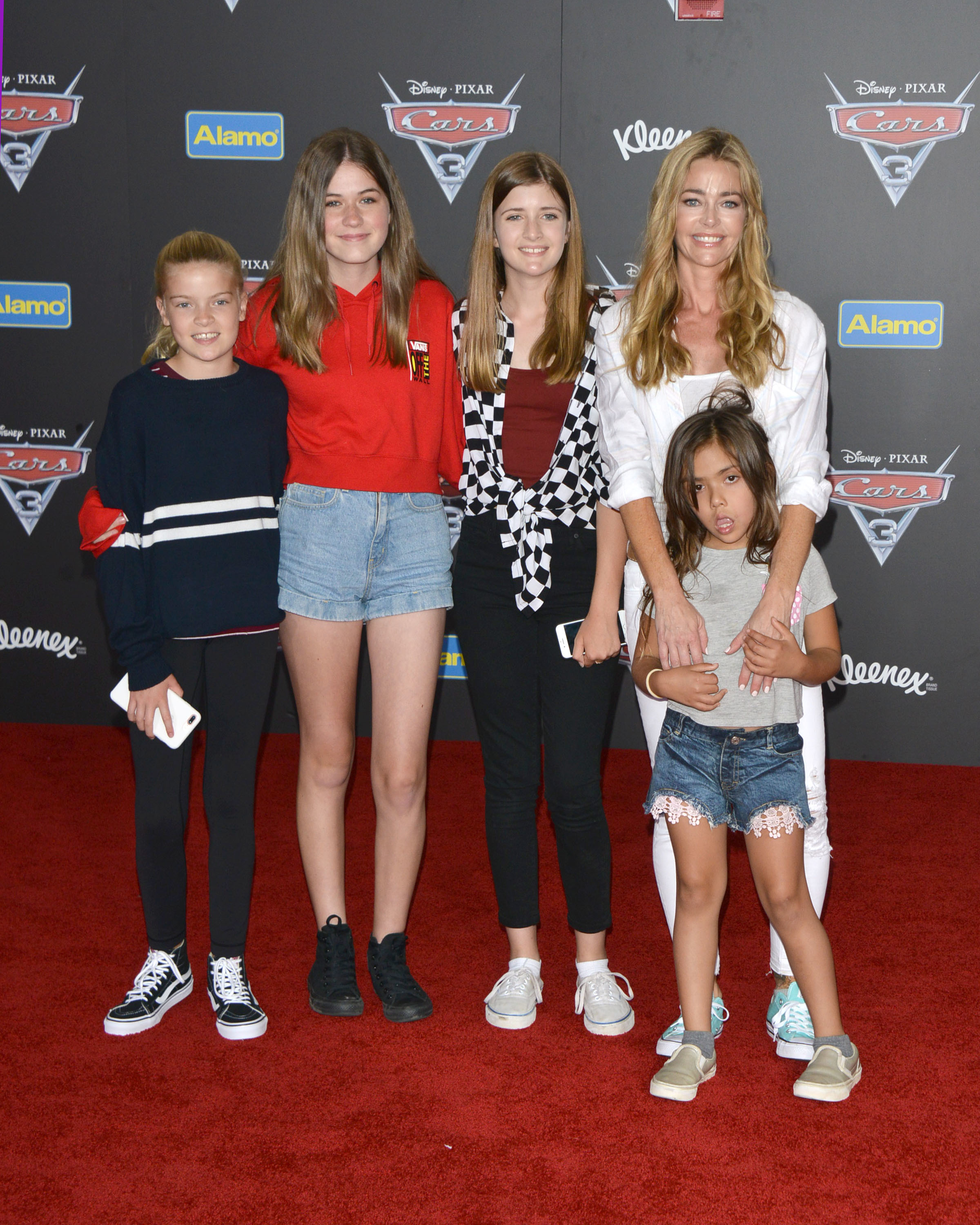 """Lola Sheen, a friend, Sam Sheen, Denise Richards and Eloise Richards attend the world premiere of Disney and Pixar's """"Cars 3"""" at the Anaheim Convention Center in Anaheim, California, on June 10, 2017."""