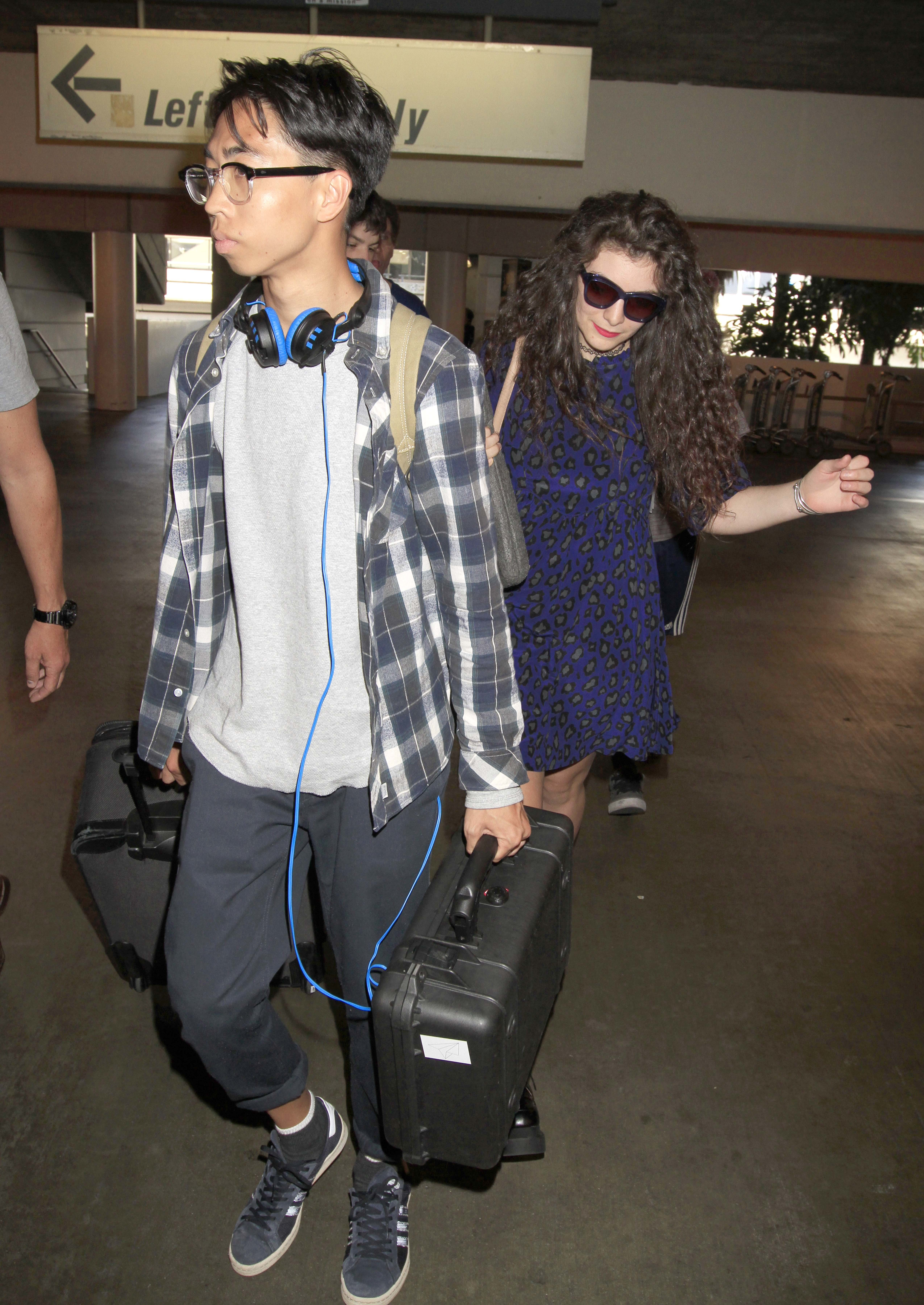James Lowe and Lorde travel through LAX Airport in Los Angeles on Jan. 22, 2014.