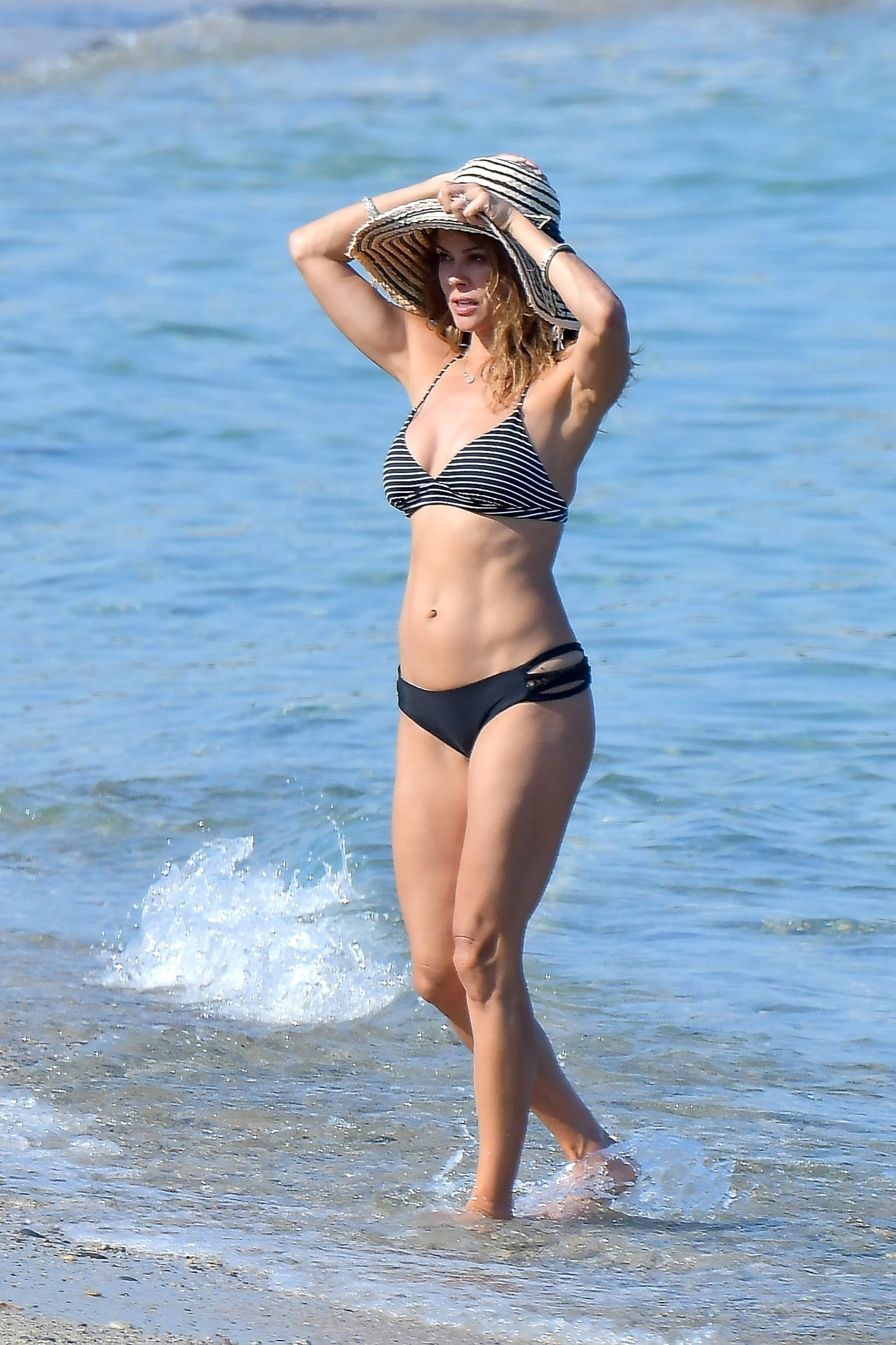 Brooke Burke soaks up the sun on a family vacation in Saint Tropez on June 17, 2017.