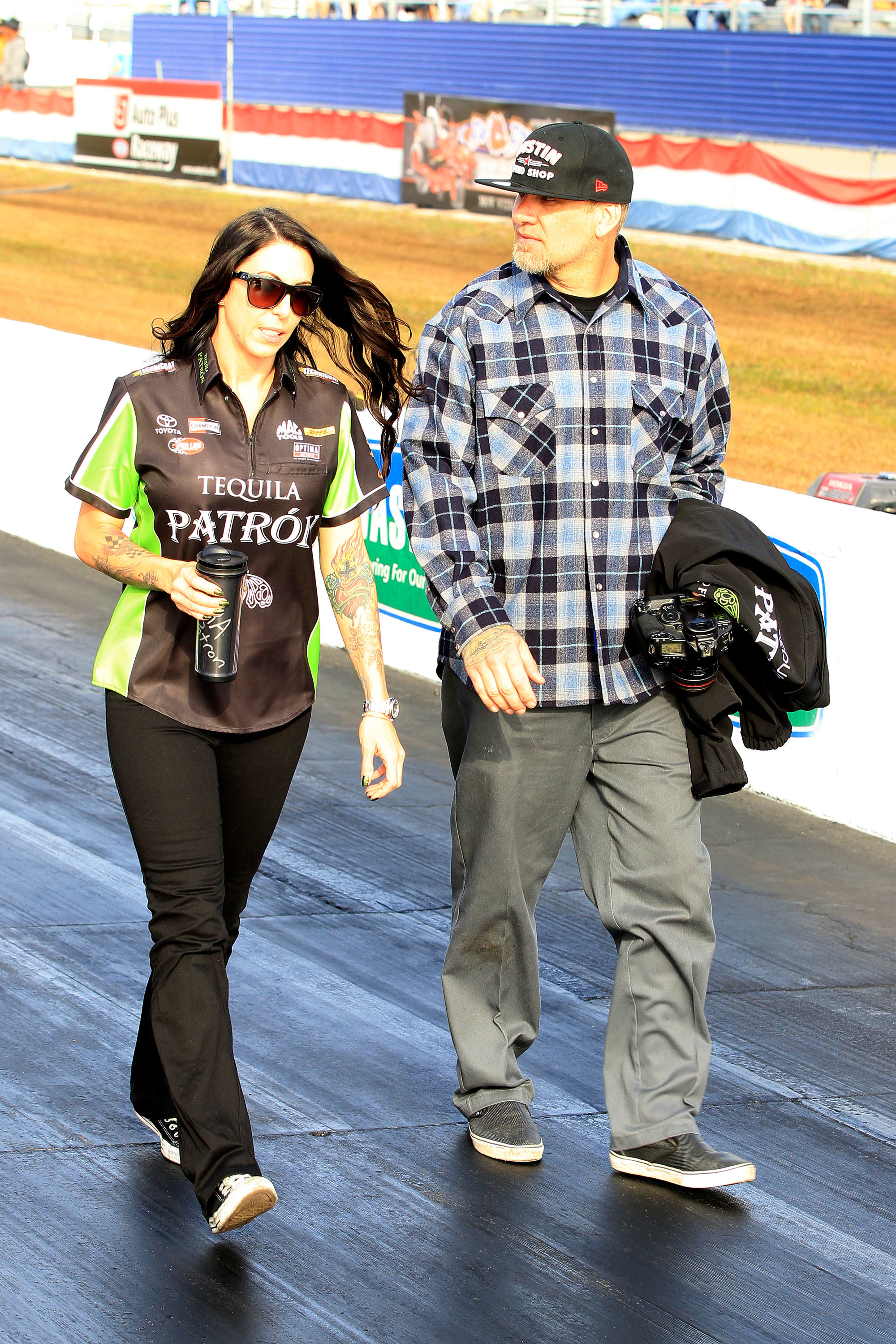 Jesse James and Alexis DeJoria at a racing event in 2013.