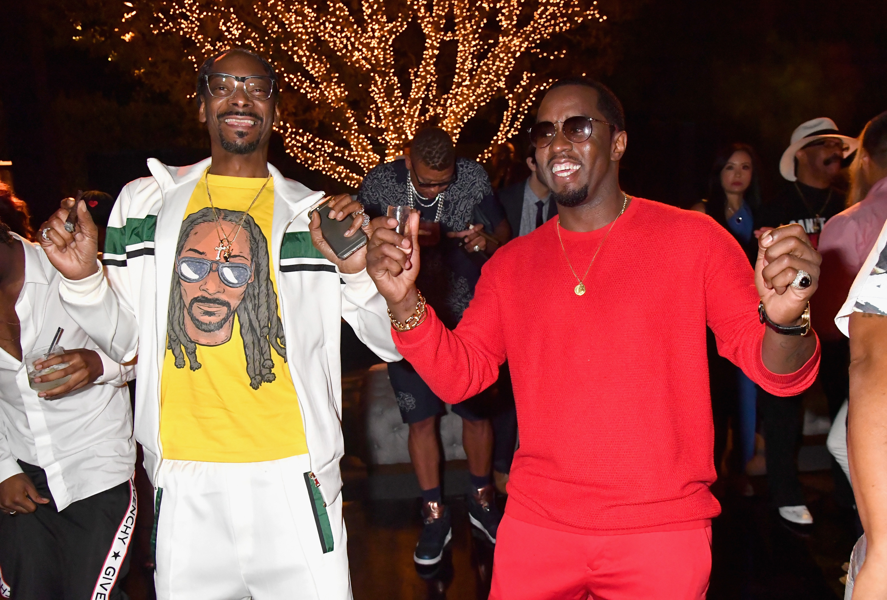 """Snoop Dogg toasts to Sean """"Diddy"""" Combs and the world premiere of Can't Stop Won't Stop at the official after party powered by CIROC Vodka and Deleon Vodka at a private residence in Los Angeles on June 21, 2017."""