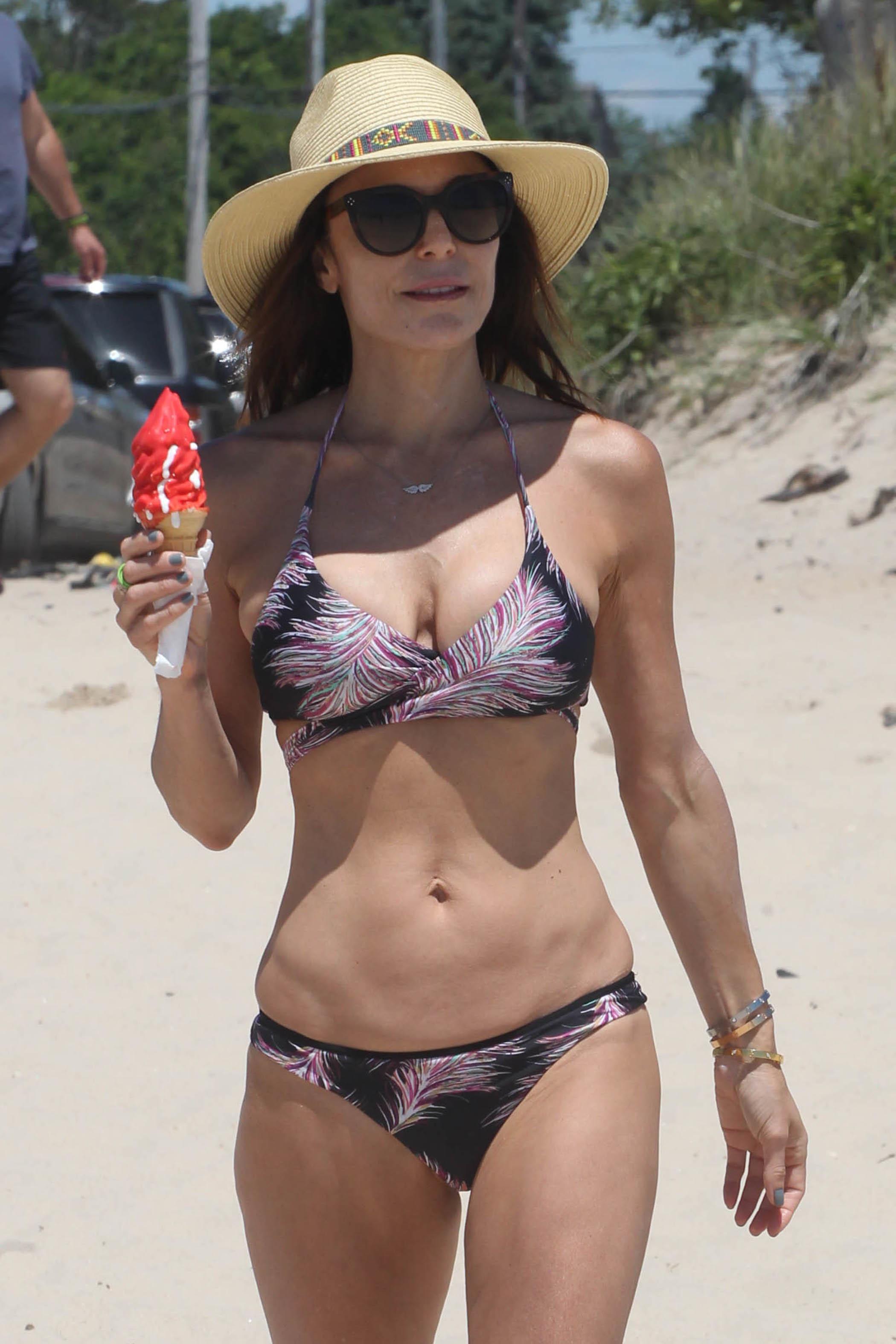 Bethenny Frankel enjoys an ice cream on the beach in the Hamptons on June 27, 2017.