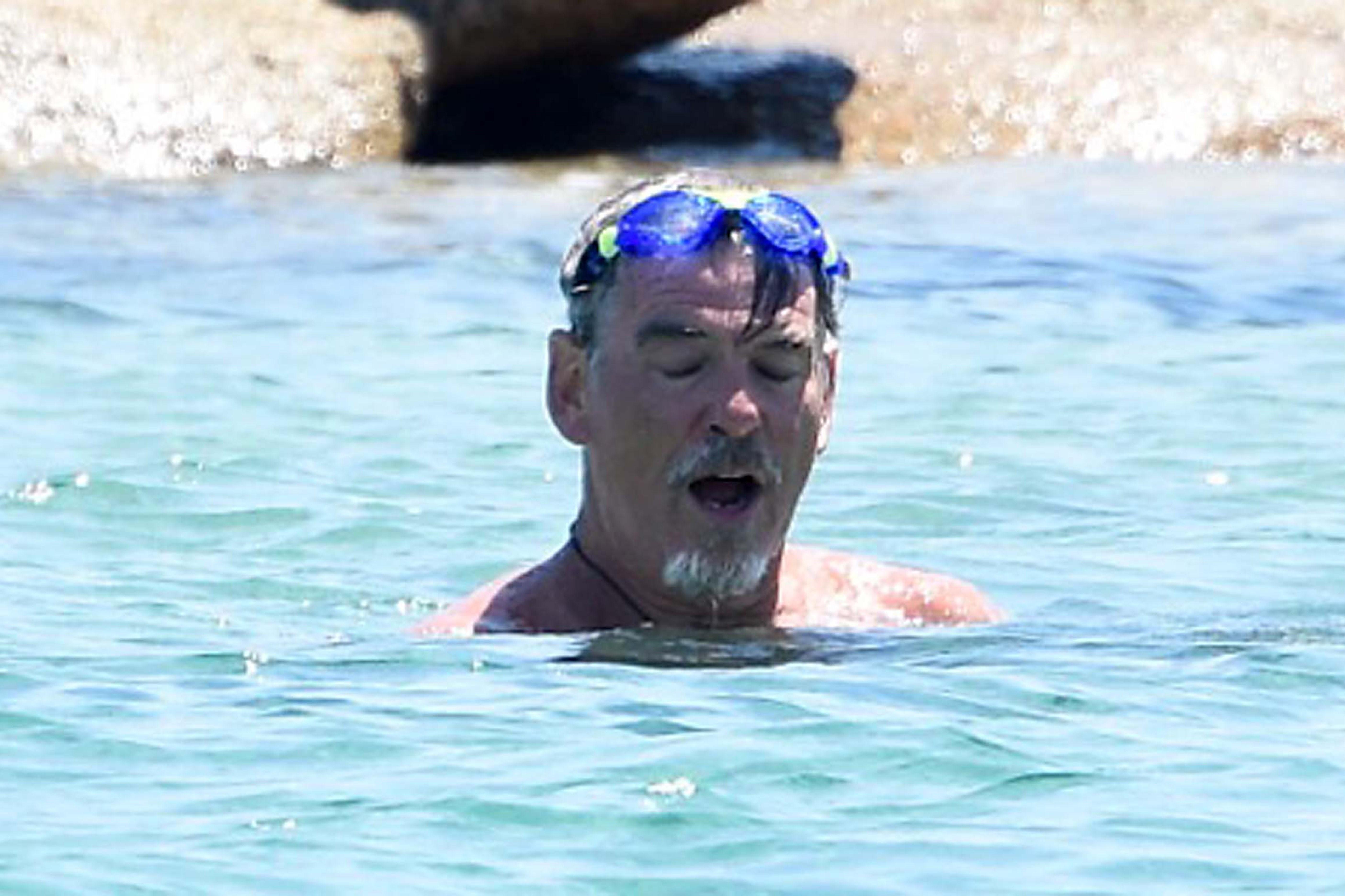 Pierce Brosnan  swims in the ocean in Italy on June 14, 2017.