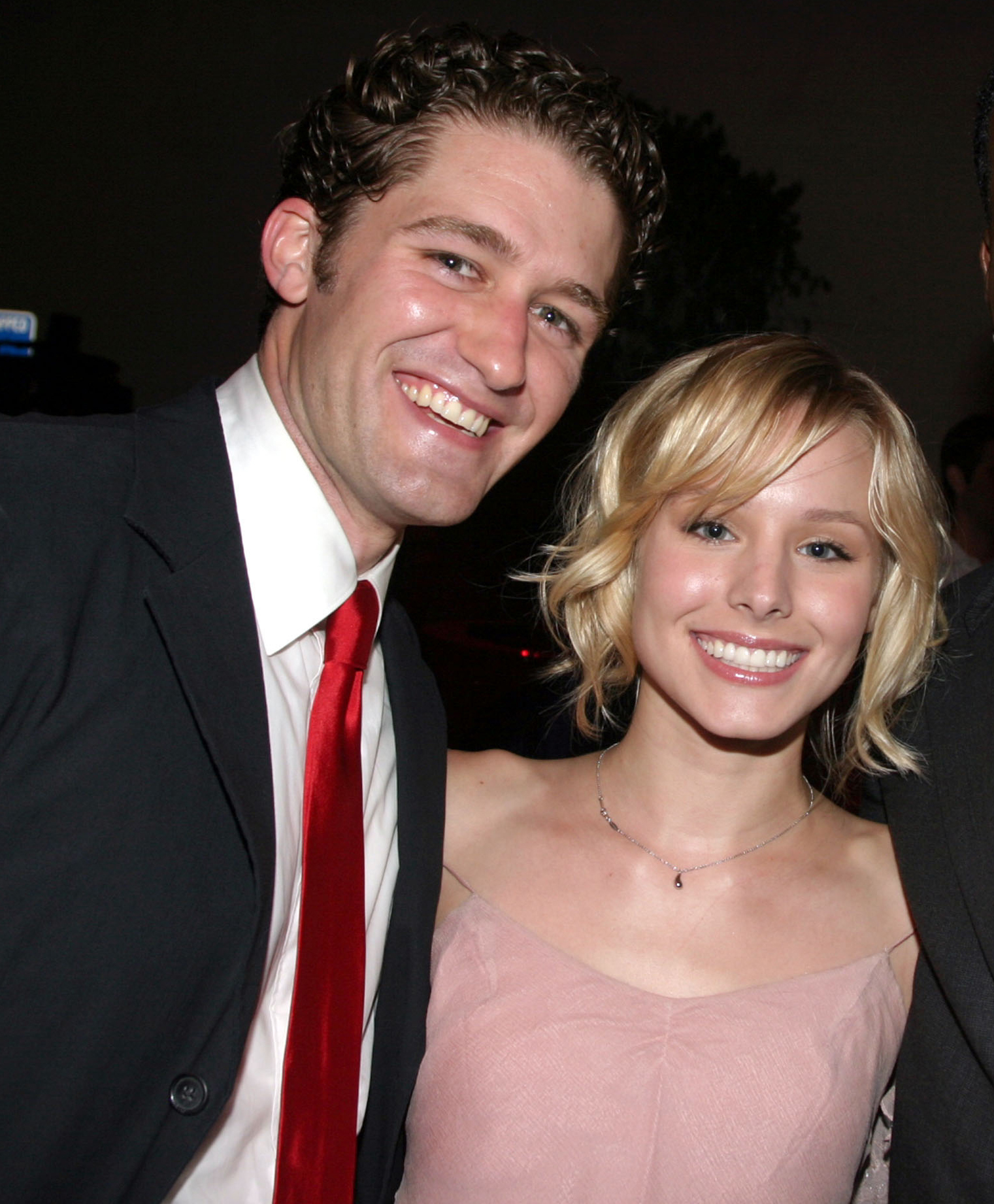 """Matthew Morrison and Kristen Bell attend an afterparty for the opening night of """"Hairspray"""" in Los Angeles on July 21, 2004."""