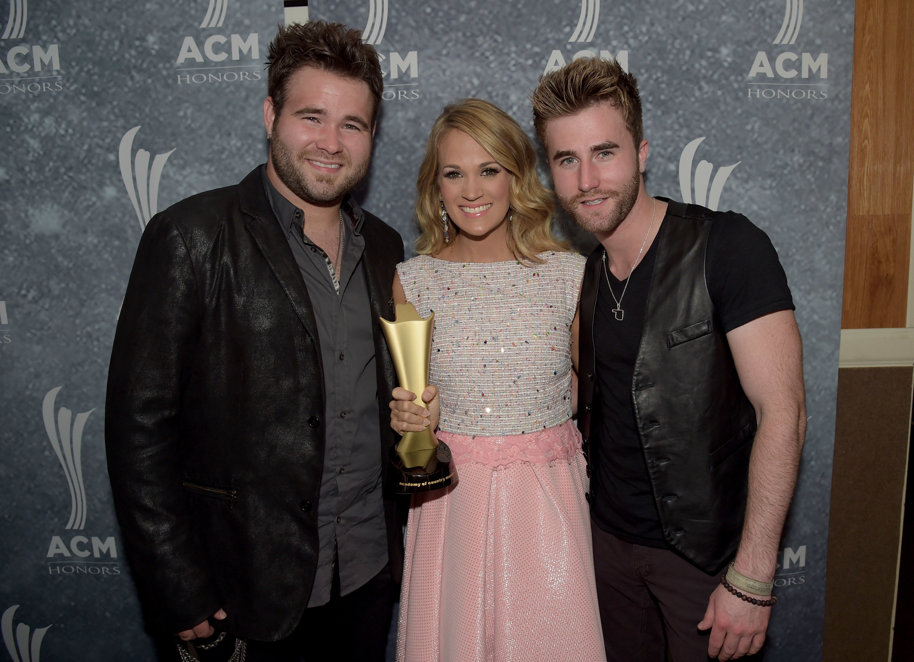 Zach Swon, Carrie Underwood and Colton Swon attend the 8th Annual ACM Honors at Ryman Auditorium in Nashville on Sept, 9, 2014.