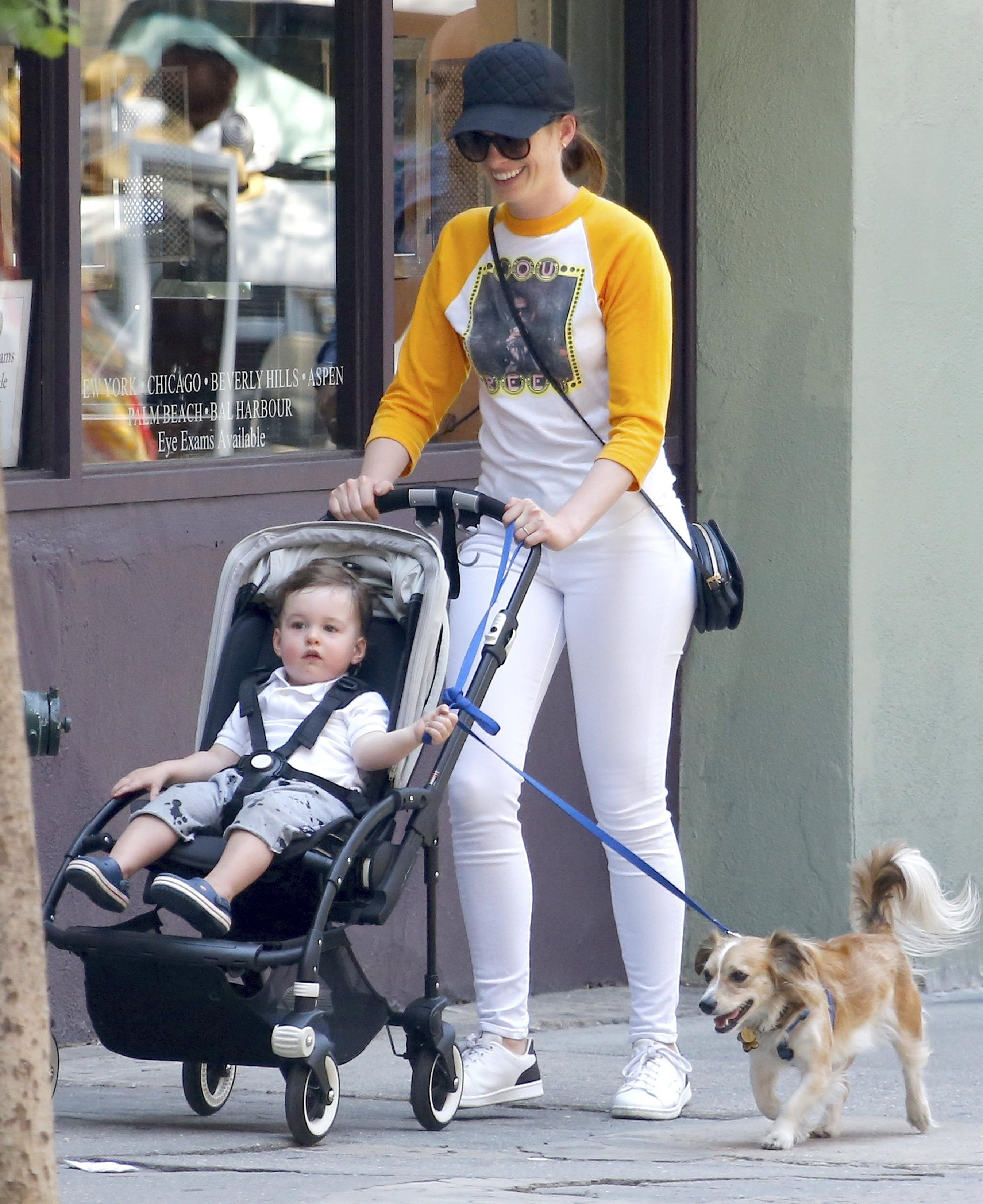 Academy Award winning actress Anne Hathaway was all smiles as she strolled with son Jonathan and the family dog while out in New York City's Soho neighborhood on June 27, 2017.