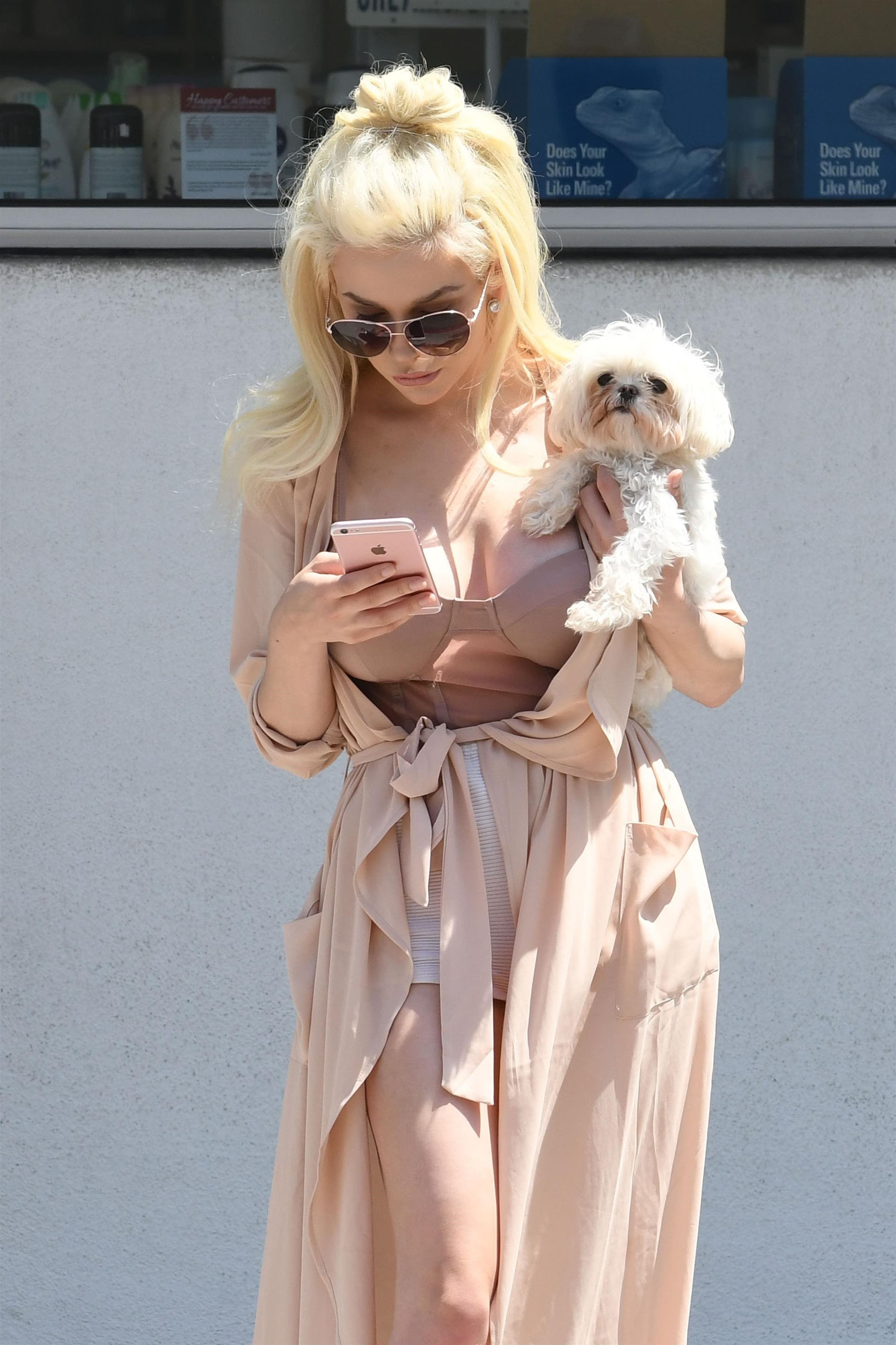 Courtney Stodden and her puppy were seen waiting for an Uber while out in Los Angeles on June 30, 2017.