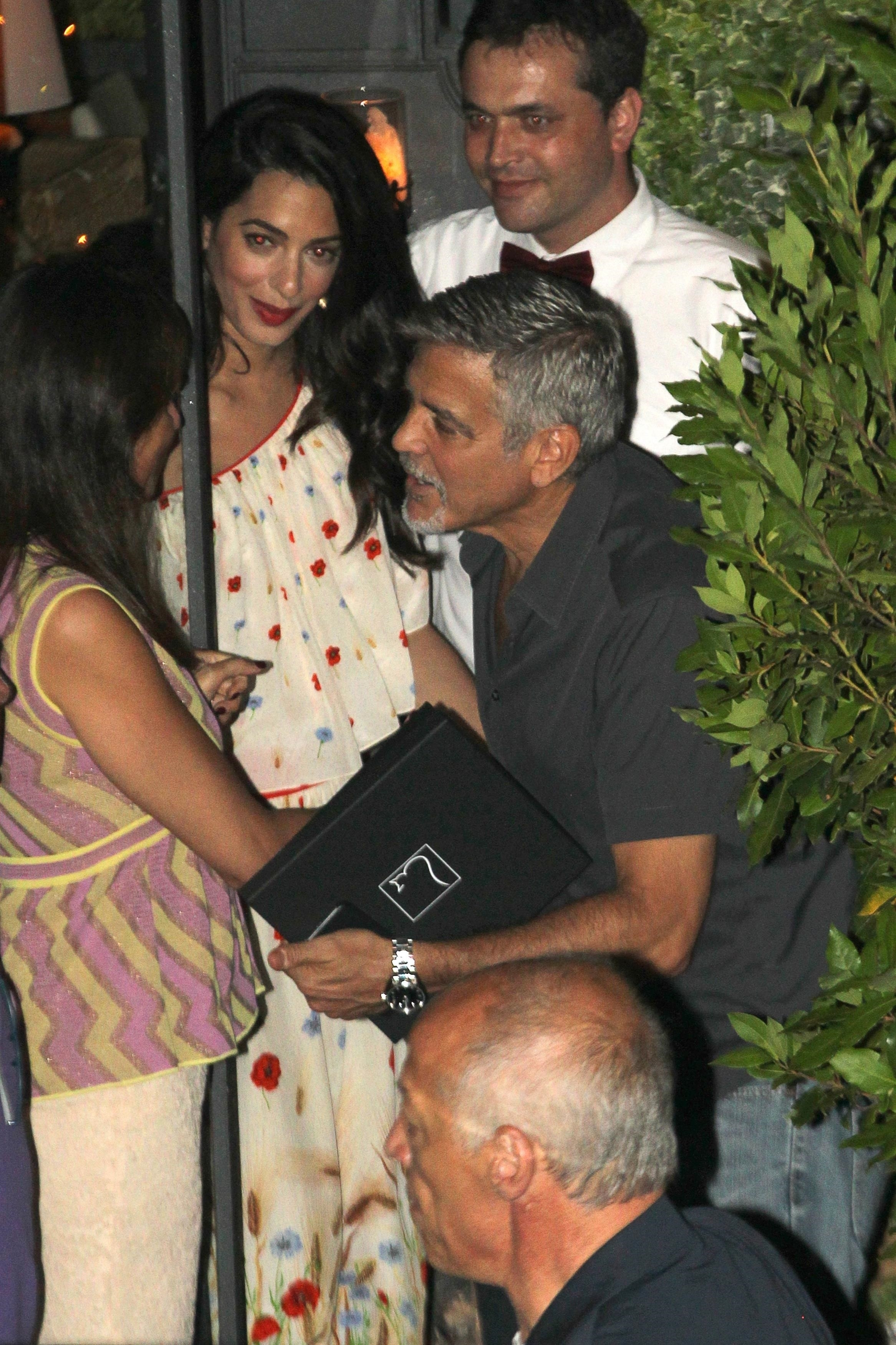 George Clooney and his wife, Amal Clooney, are spotted leaving dinner at Il Gatto Nero in Como, Italy, on July 11, 2017.