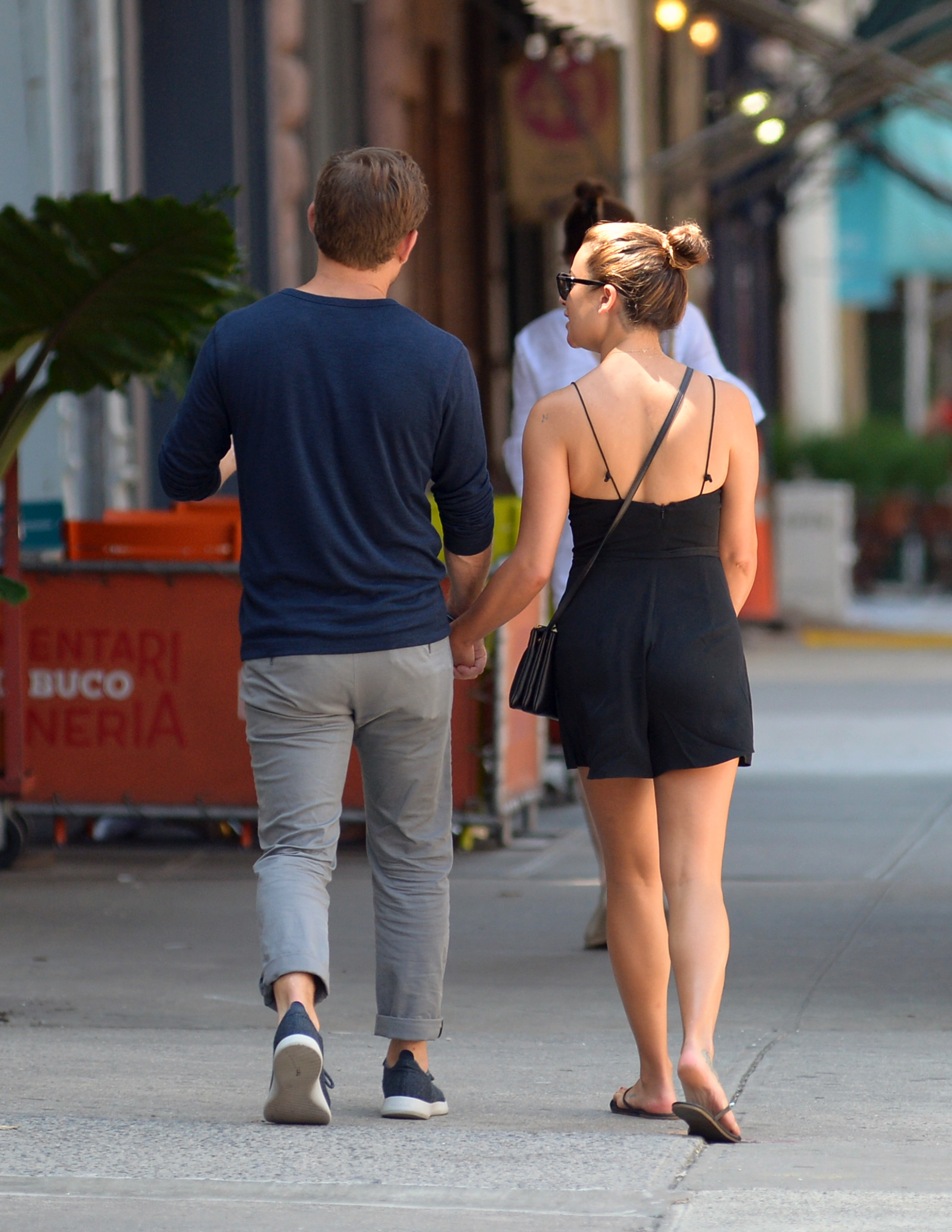 Lea Michele holds hands with Zandy Reich in New York City on July 18, 2017.