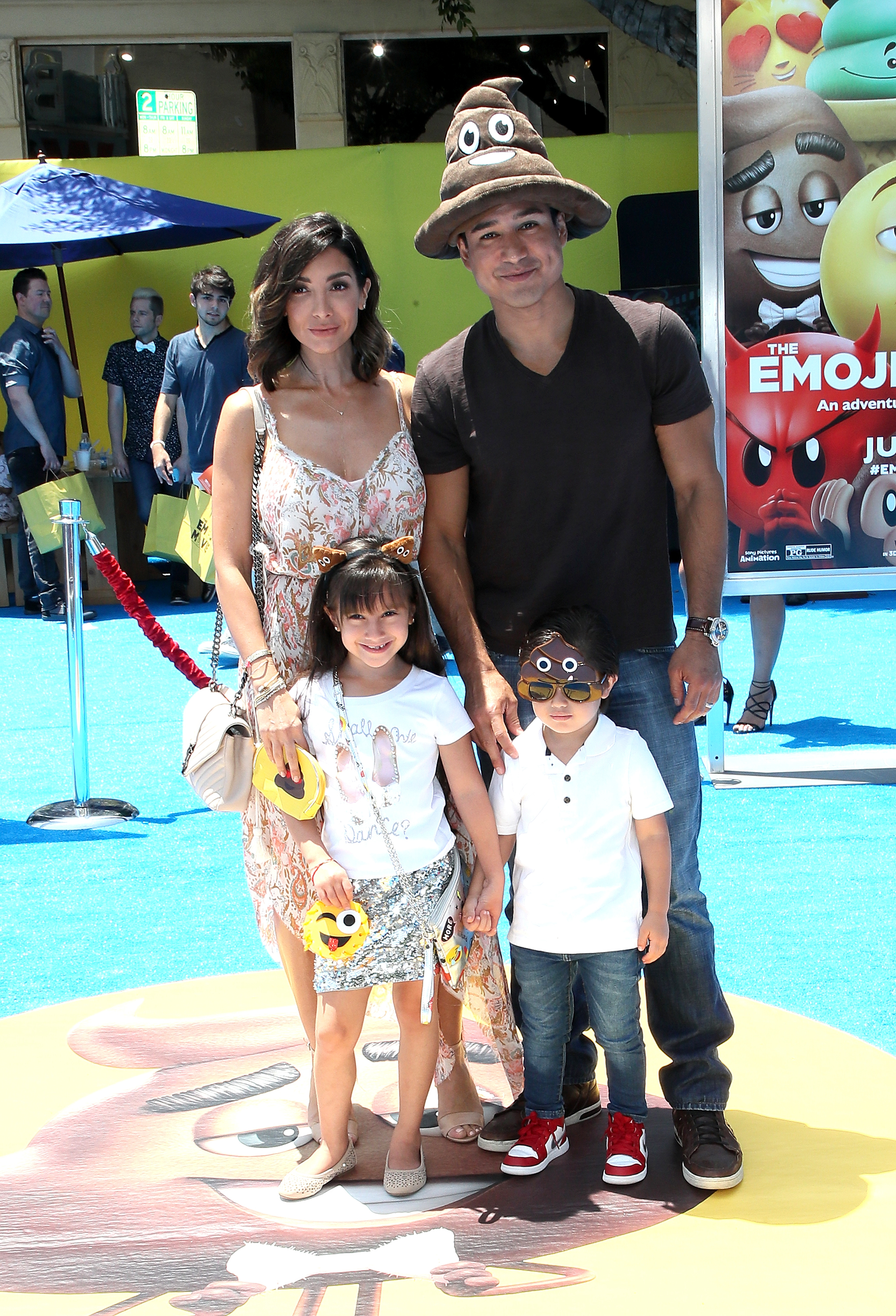 "Courtney Laine Mazza, Gia Francesca Lopez, Dominic Lopez and television personality Mario Lopez attend the premiere of Columbia Pictures and Sony Pictures Animation's ""The Emoji Movie"" at Regency Village Theatre in Westwood, Calif., on July 23, 2017."