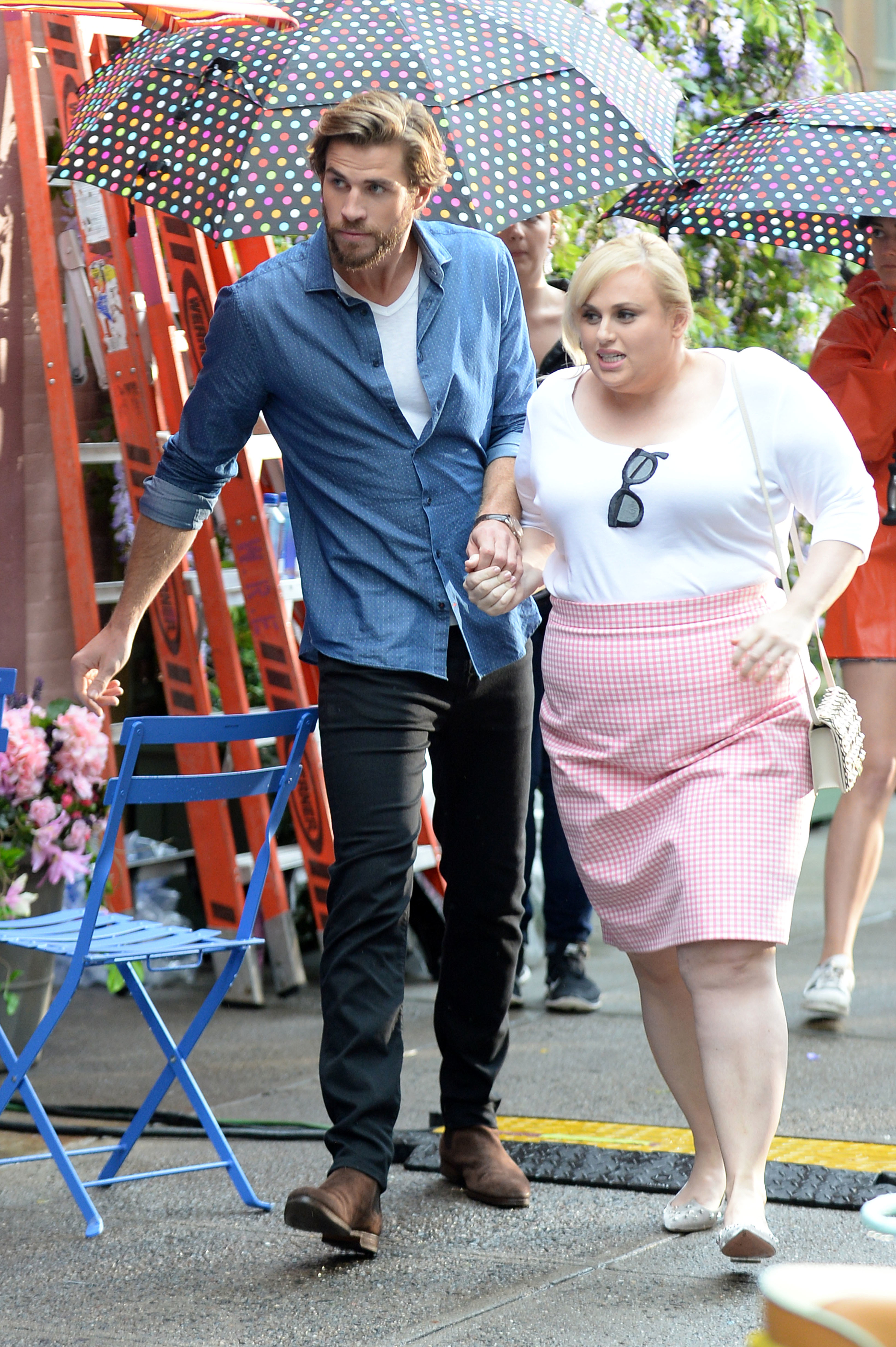 """Liam Hemsworth and Rebel Wilson were spotted filming """"Isn't It Romantic"""" in New York City on July 22, 2017."""