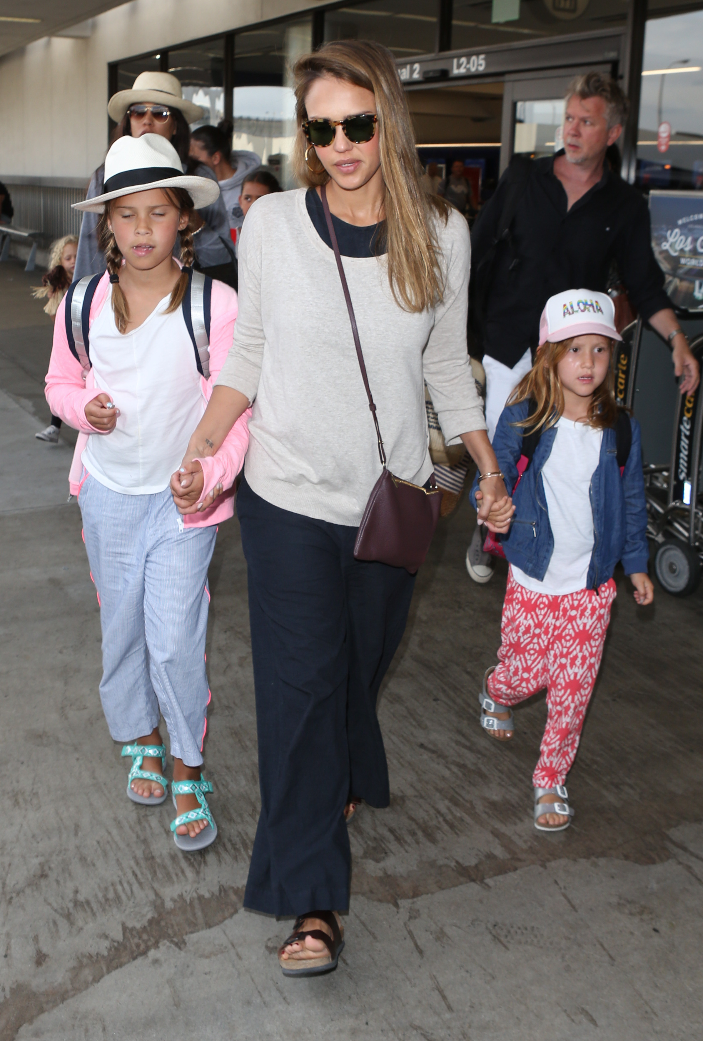 Jessica Alba arrives at LAX airport in Los Angeles with daughters Honor and Haven Warren on July 24, 2017.