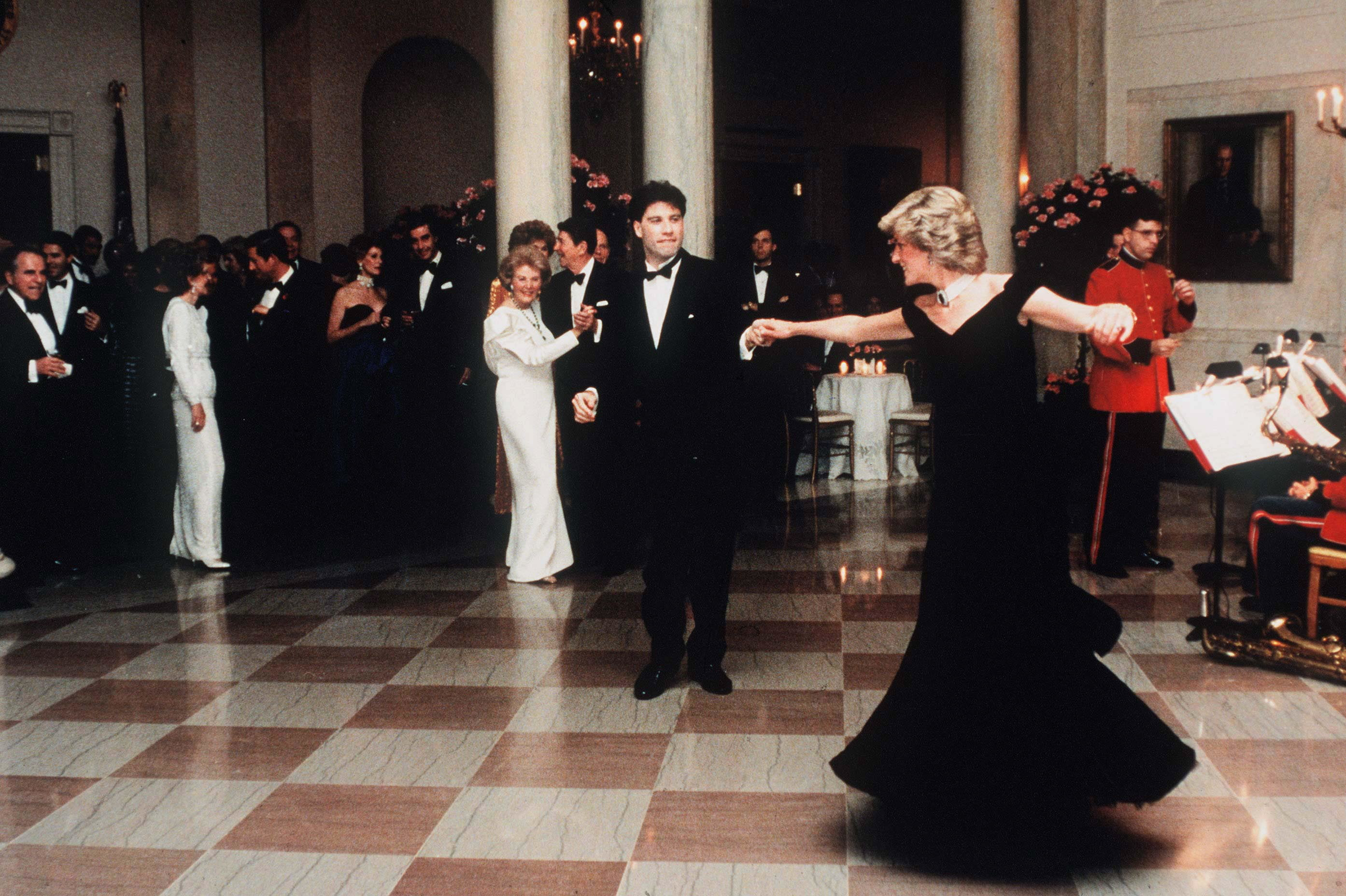 Princess Diana dances with John Travolta at The White House in Nov. 11, 1985.