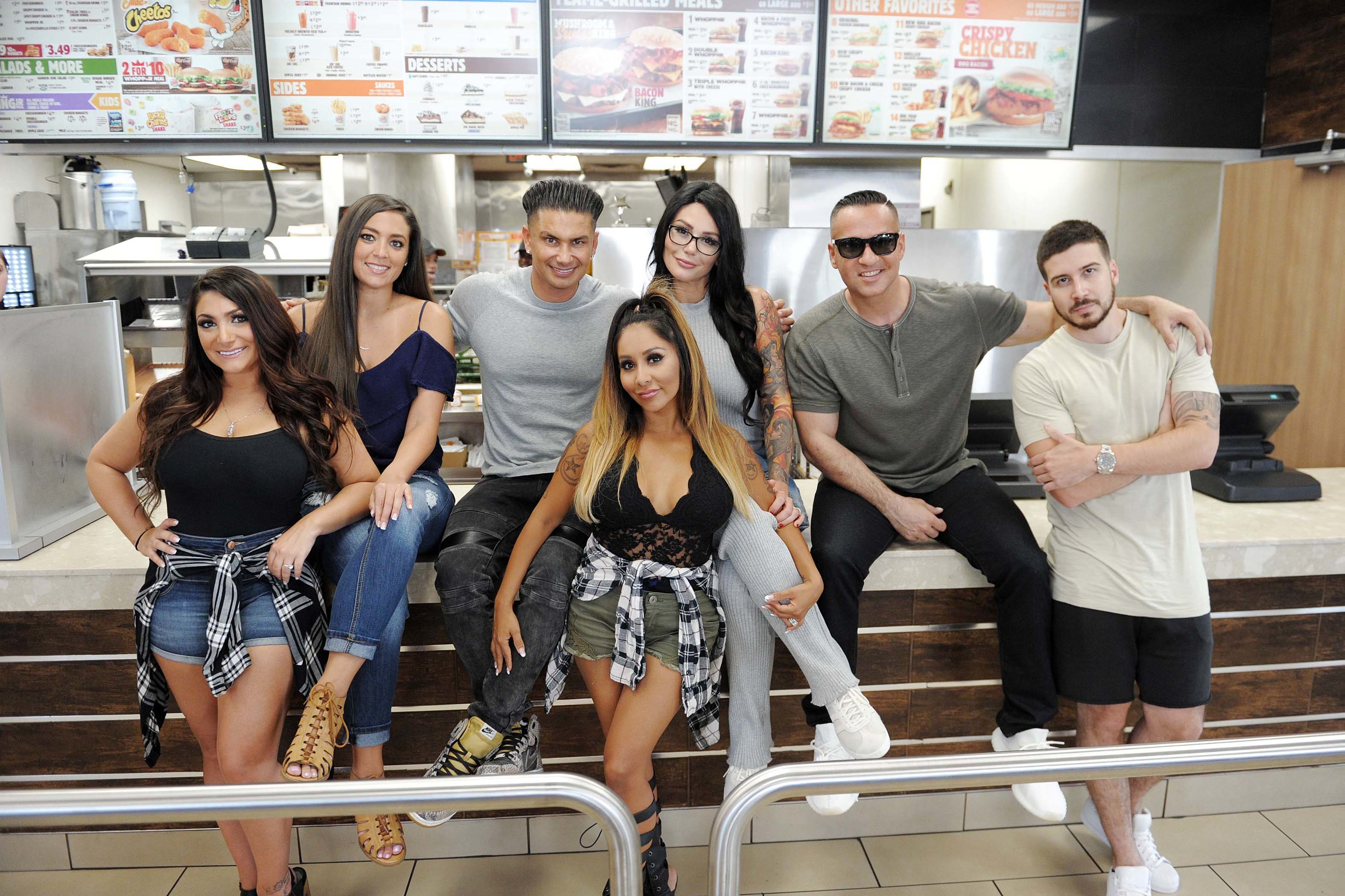 Mike Sorrentino, Nicole Polizzi, Pauly Delvecchio, Jenni Farley, Deena Cortese, Vinny Guadagnino and Sammi Giancola try the new Chicken Parmesan Sandwich at Burger King on July 11, 2017.