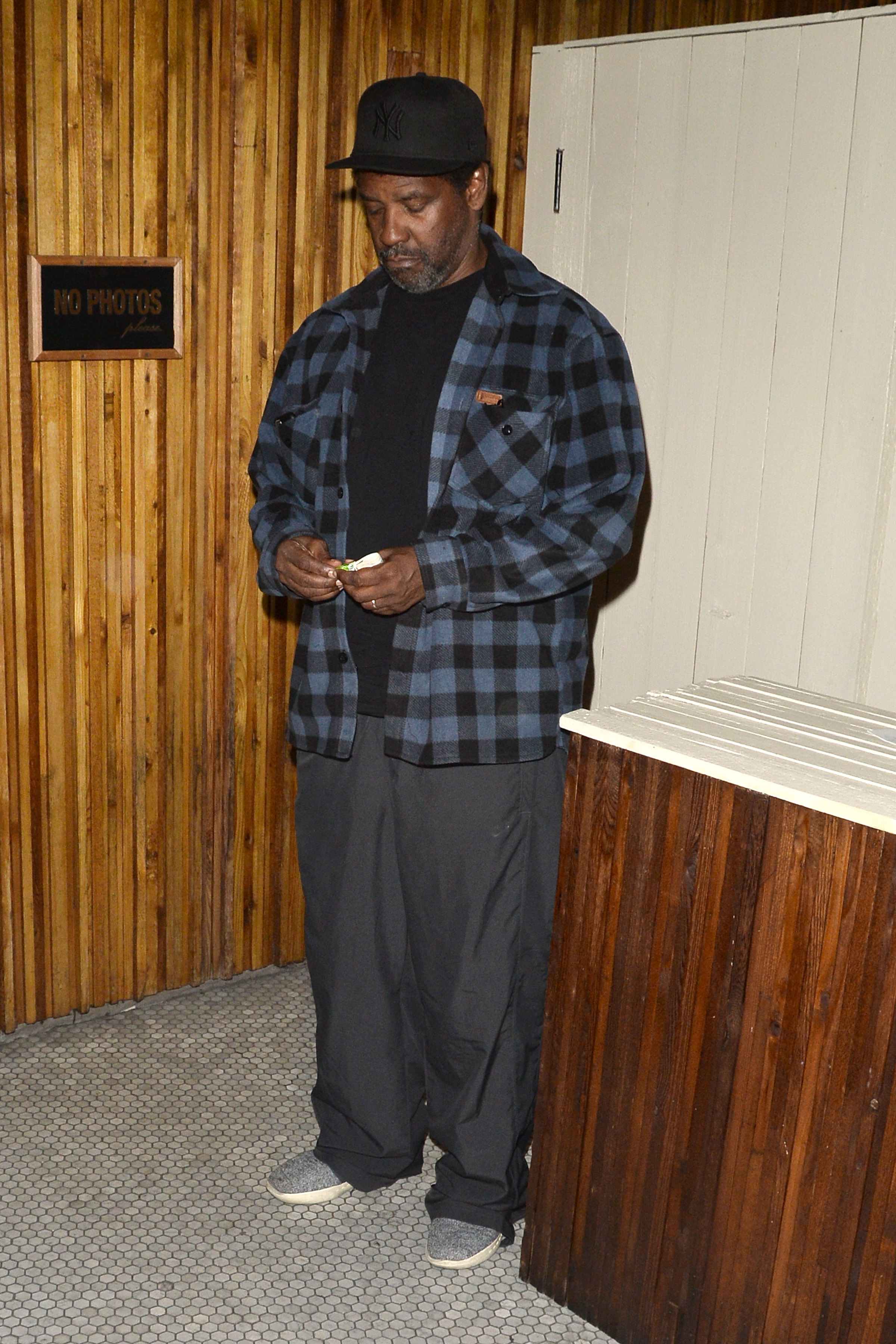 "Iconic actor Denzel Washington was spotted waiting for the valet after having dinner at hotspot ""The Nice Guy"" in Los Angeles on July 26, 2017."