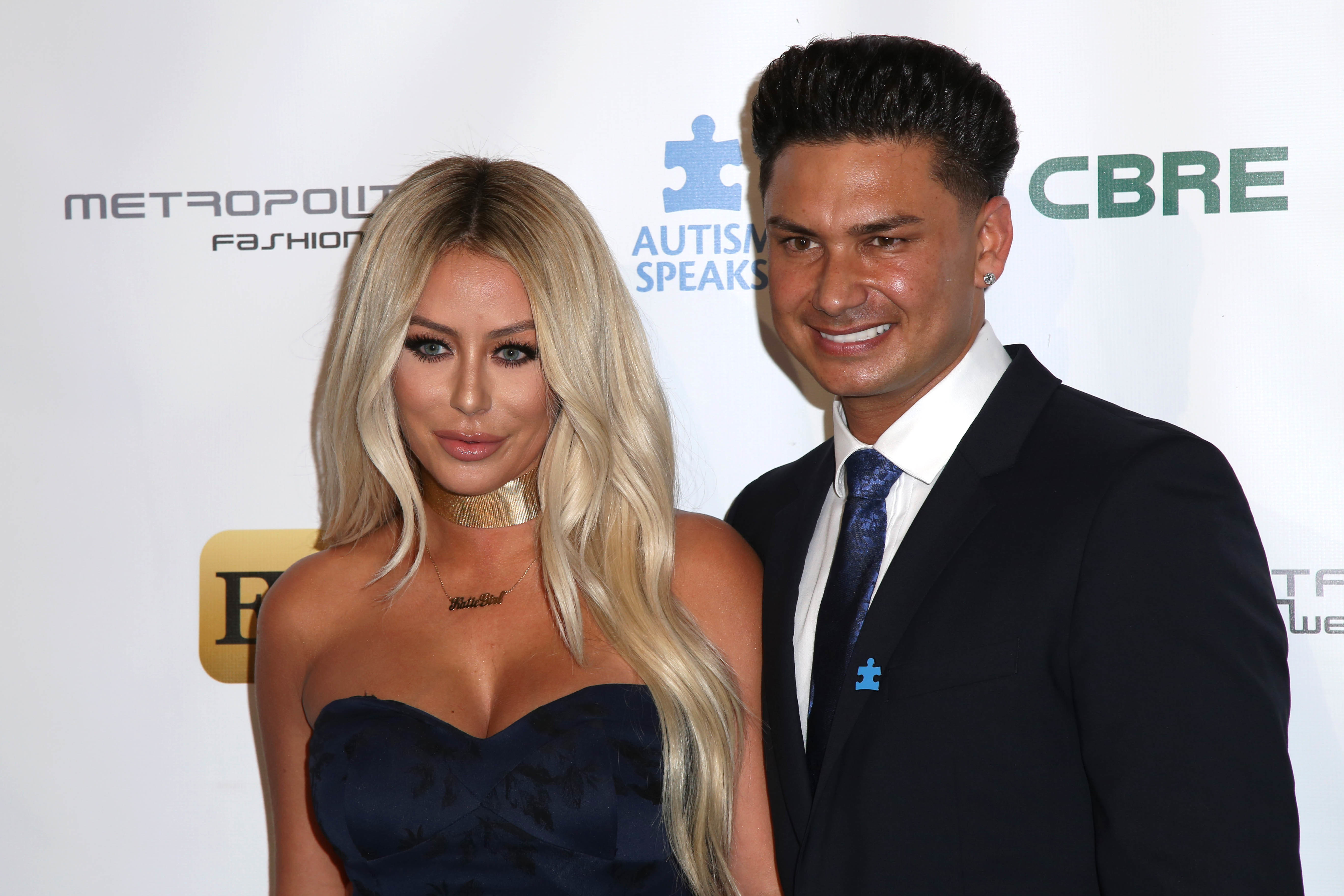 Aubrey O'Day and Paul DelVecchio attends Autism Speaks La Vie En Blue Fashion Gal in Los Angeles on Sept. 29, 2016.