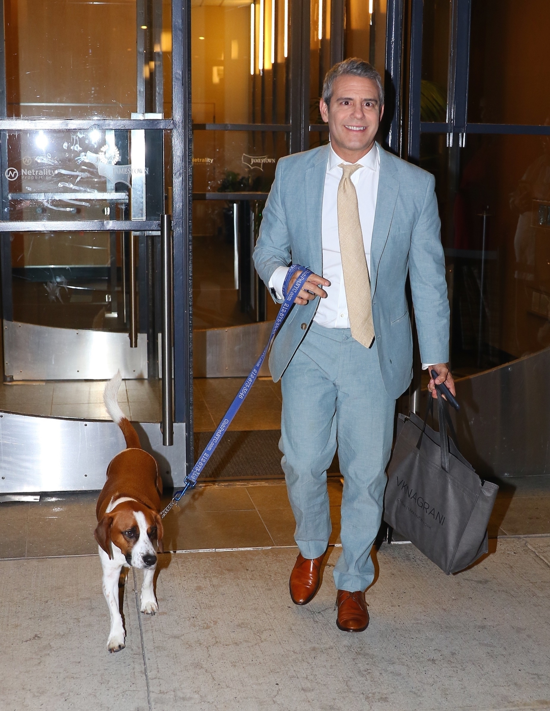 Andy Cohen and his dog Wacha leave the studio after filming an episode of 'Watch What Happens Live' in New York City on Aug. 1, 2017.