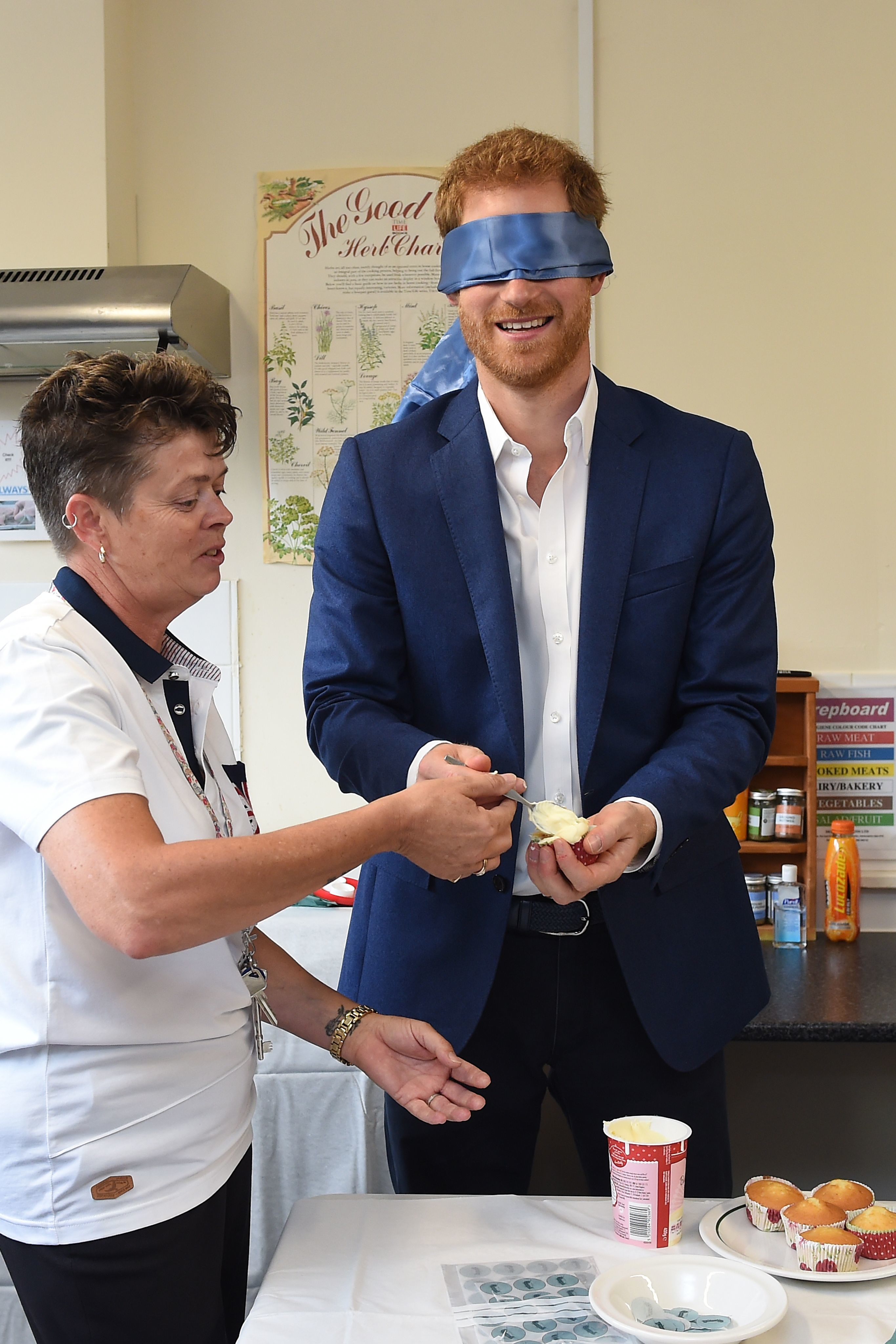 Prince Harry decorates a cake  in Ipswich, England, on July 20, 2017.