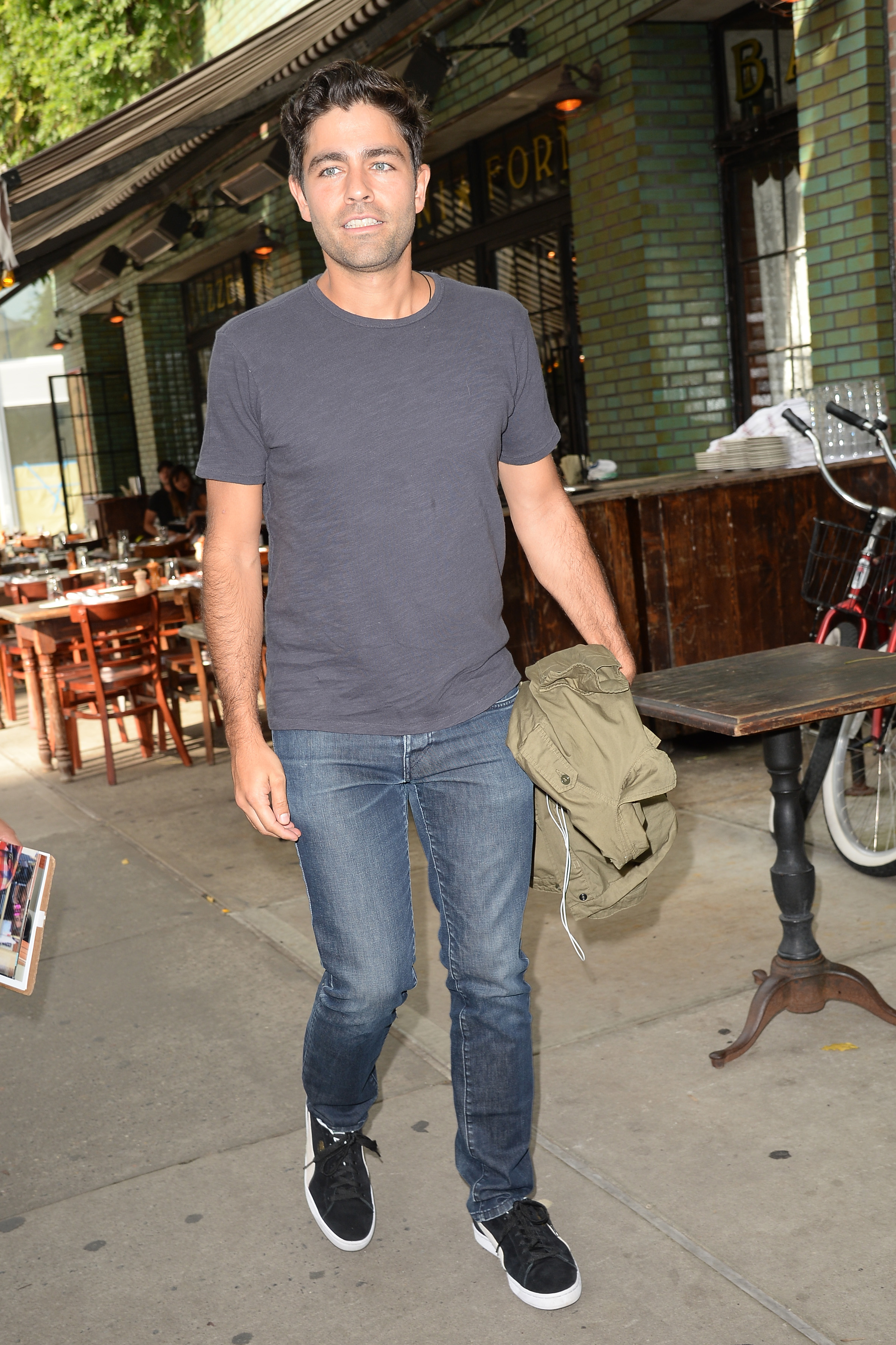 Adrian Grenier is spotted out and about in New York City on Aug. 8, 2017.