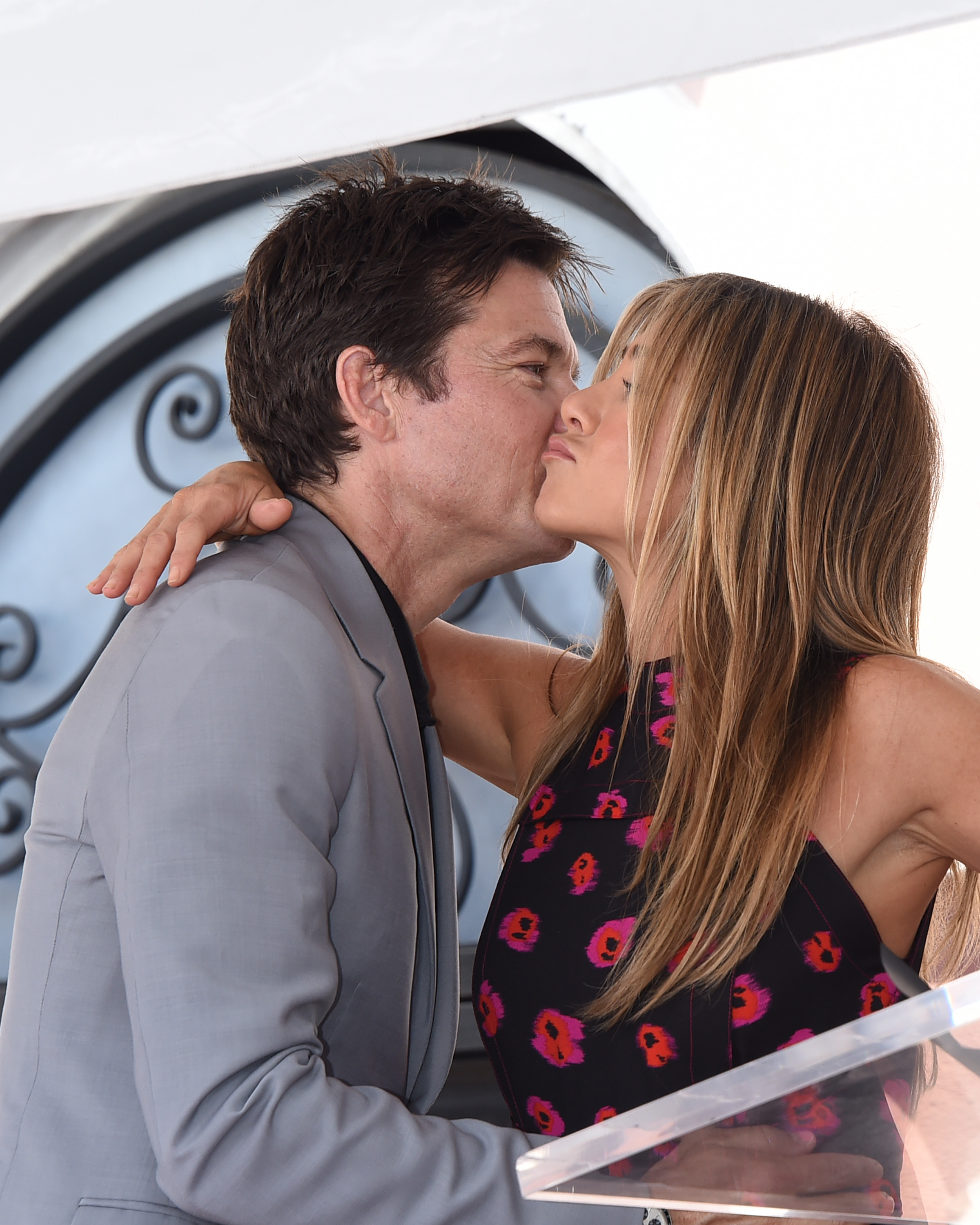 Longtime friends Jennifer Aniston and Jason Bateman shared a friendly kiss while attending his Hollywood Walk of Fame ceremony on July 25, 2017.