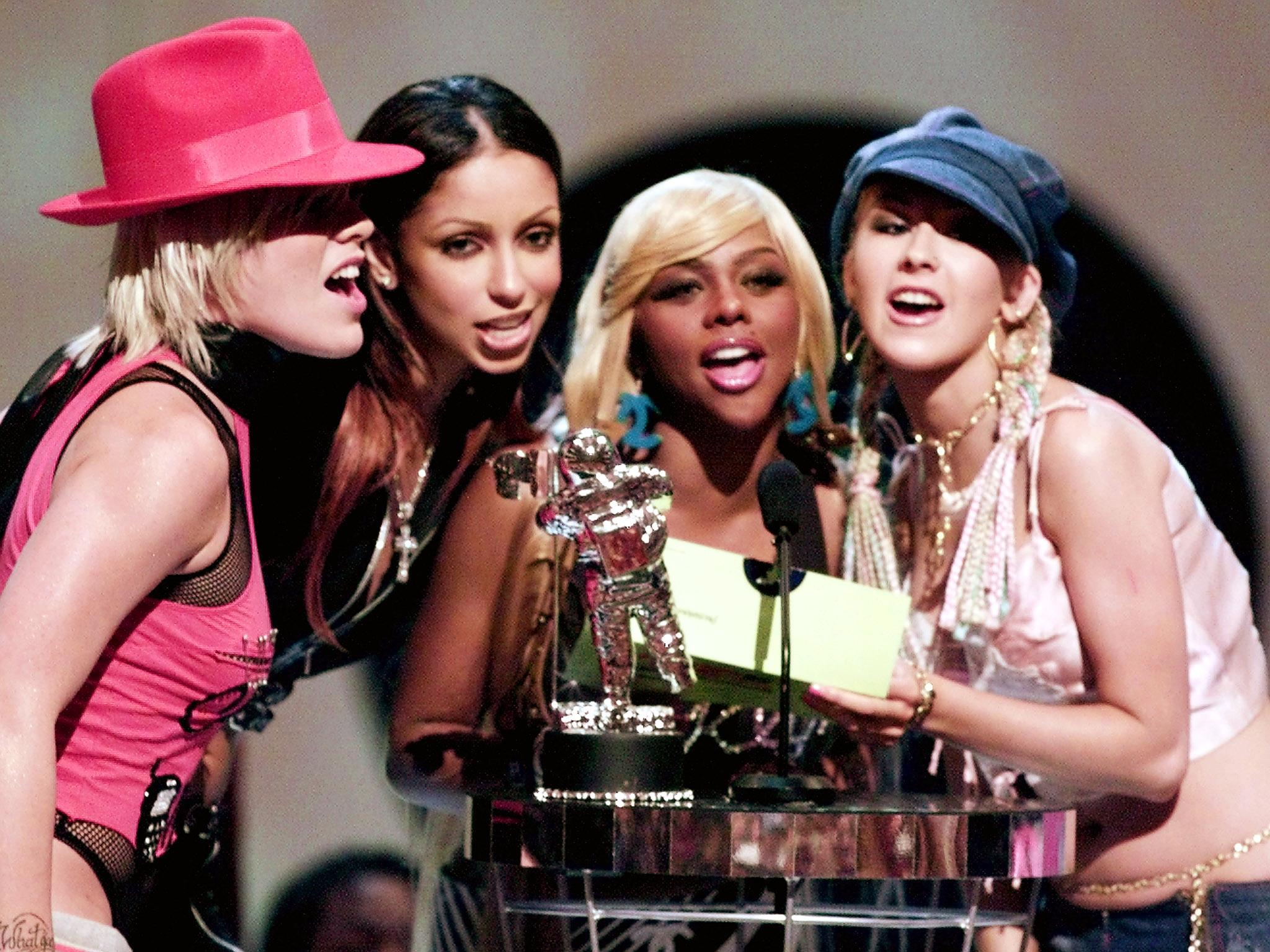 Pink, Mya, Lil Kim and Christina Aguilera present the best male video prize at the MTV Video Music Awards in New York City on Sept. 6, 2001.