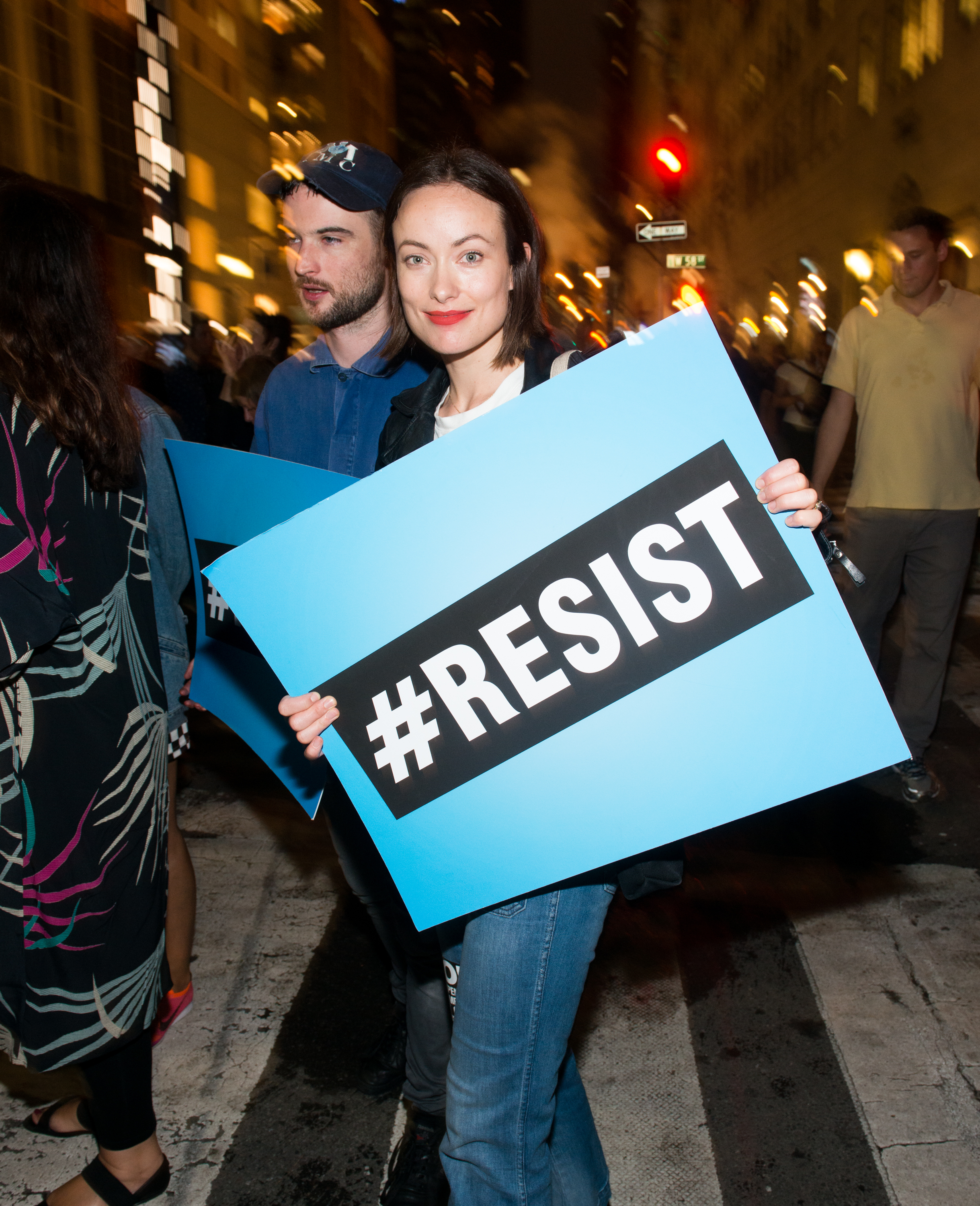 Olivia Wilde joins Michael Moore as he leads his Broadway audience to Trump Tower during a protest in New York City on August 15, 2017.