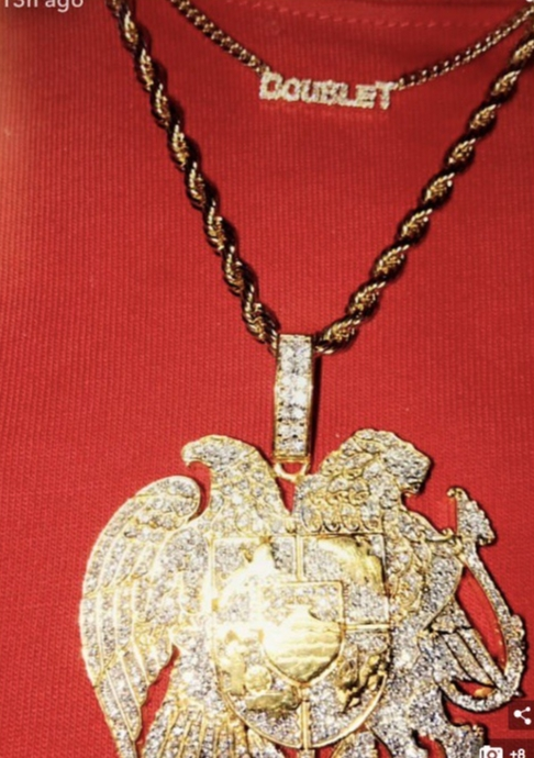 """'Look at my Armenian crest that my baby made for me. I love it. Let's go, Armenia.""  Khloe Kardashia, who shared an image of the necklace her boyfriend Tristan Thompson gave her on Snapchat on Aug. 16, 2017"