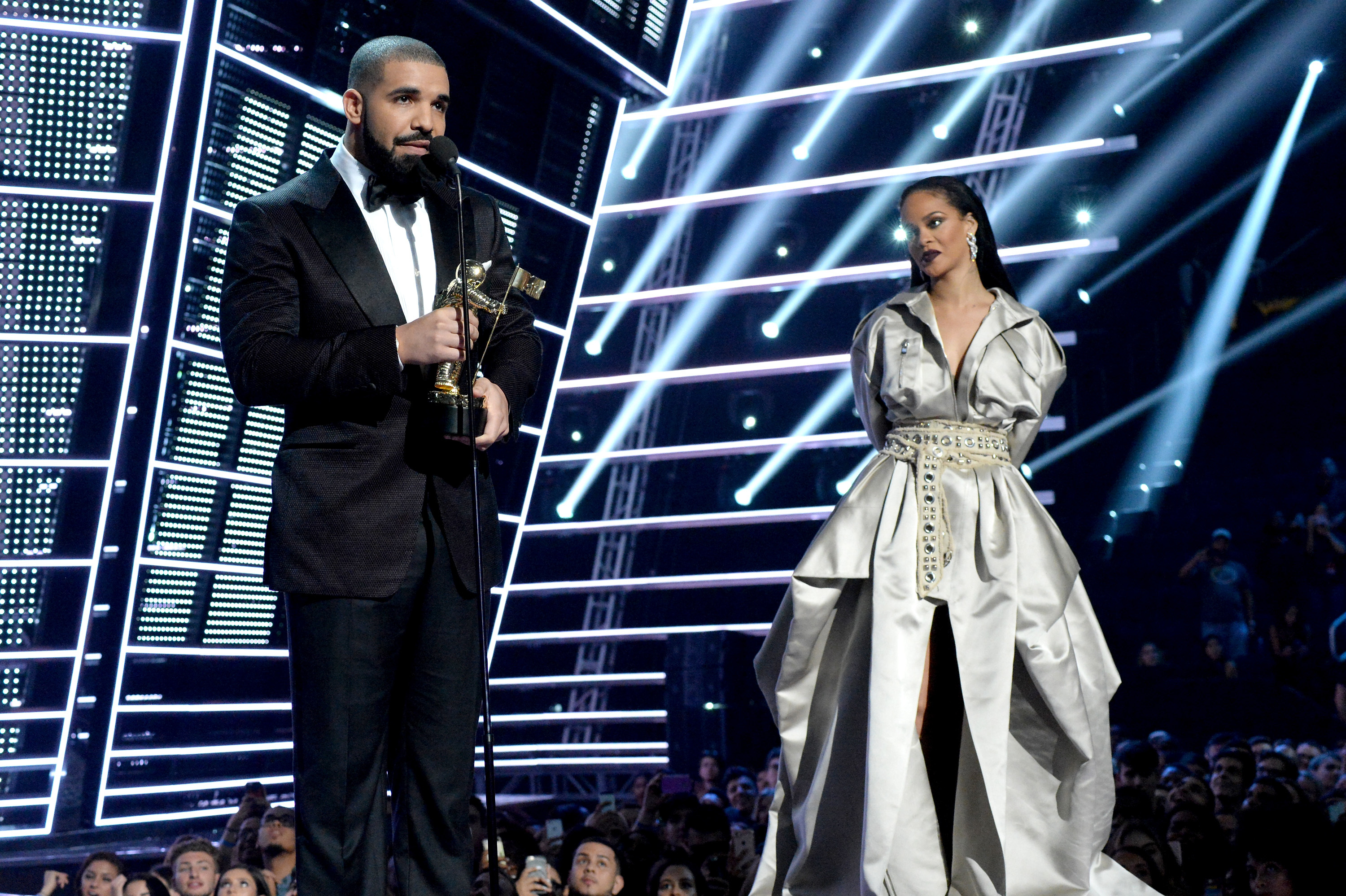 Drake presents the Michael Jackson Video Vanguard Award to recipient Rihanna onstage during the 2016 MTV Video Music Awards at Madison Square Garden in New York City on Aug. 28, 2016.