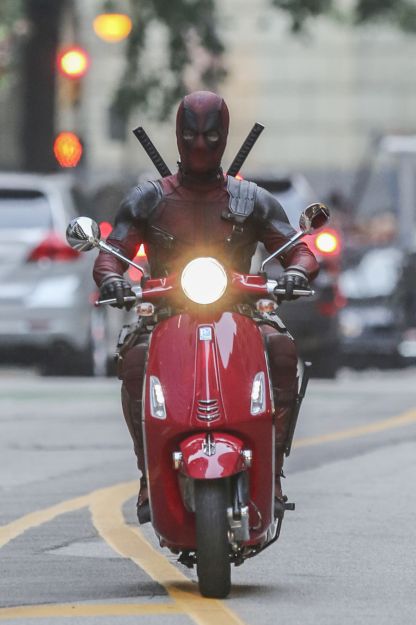 Ryan Reynolds rides a red Vespa in Vancouver on Aug. 9, 2017.