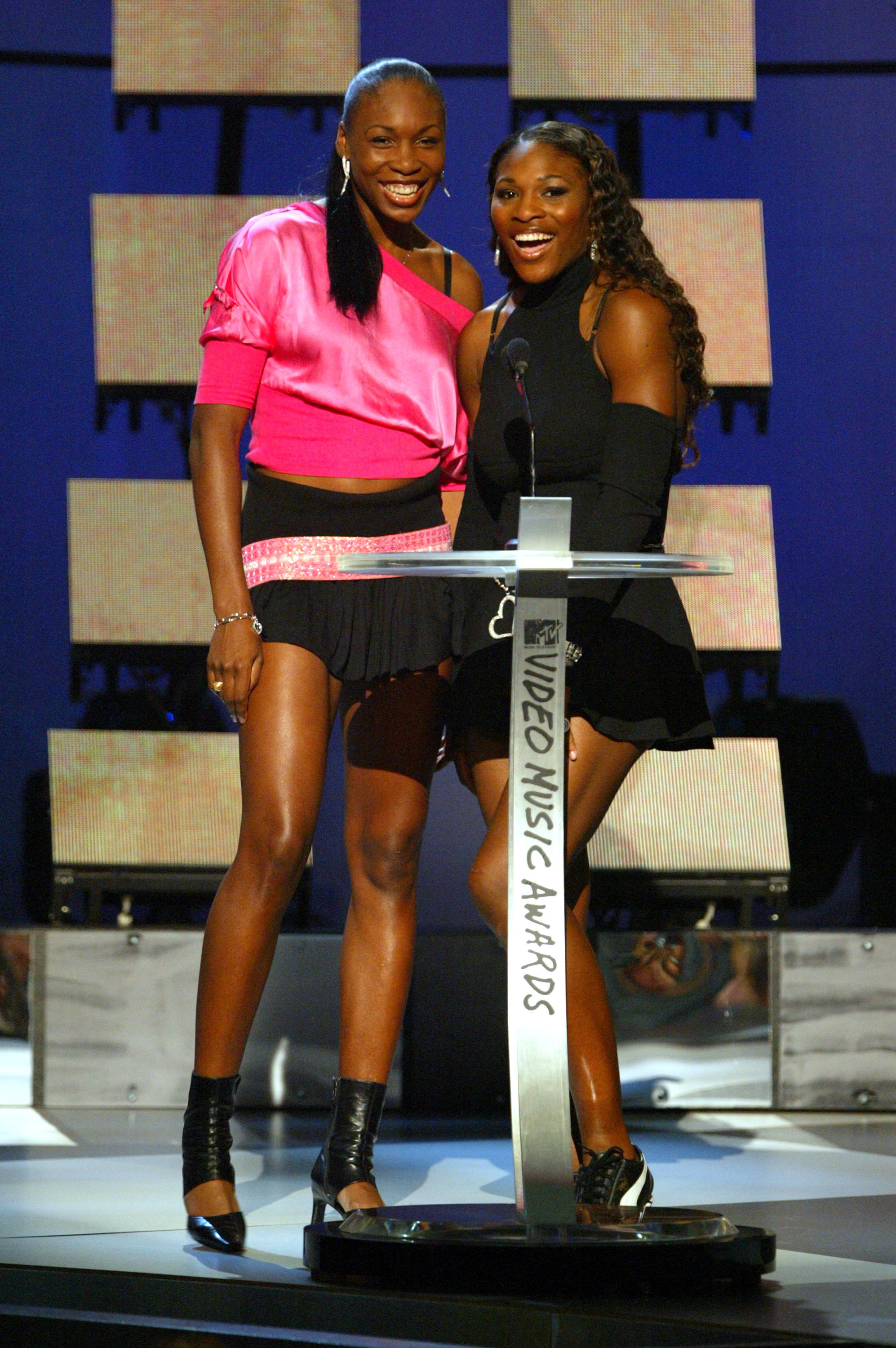 Venus Williams and Serena Williams announce Best Male Video at the 2003 MTV Video Music Awards at the Radio City Music Hall in New York City on Aug. 28, 2003.
