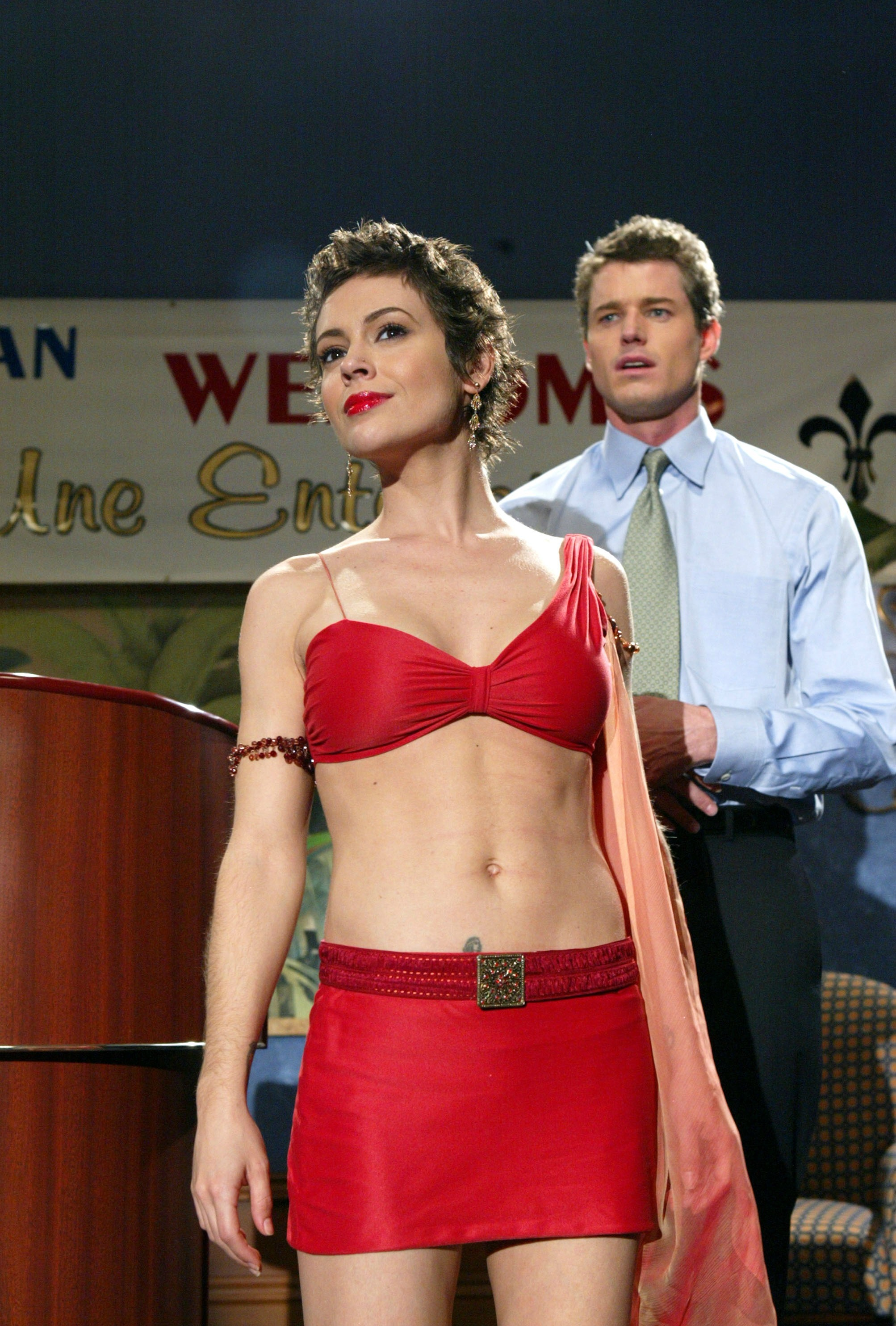 Alyssa Milano and Eric Dane appear in this scene still of the TV series Charmed from 2003.