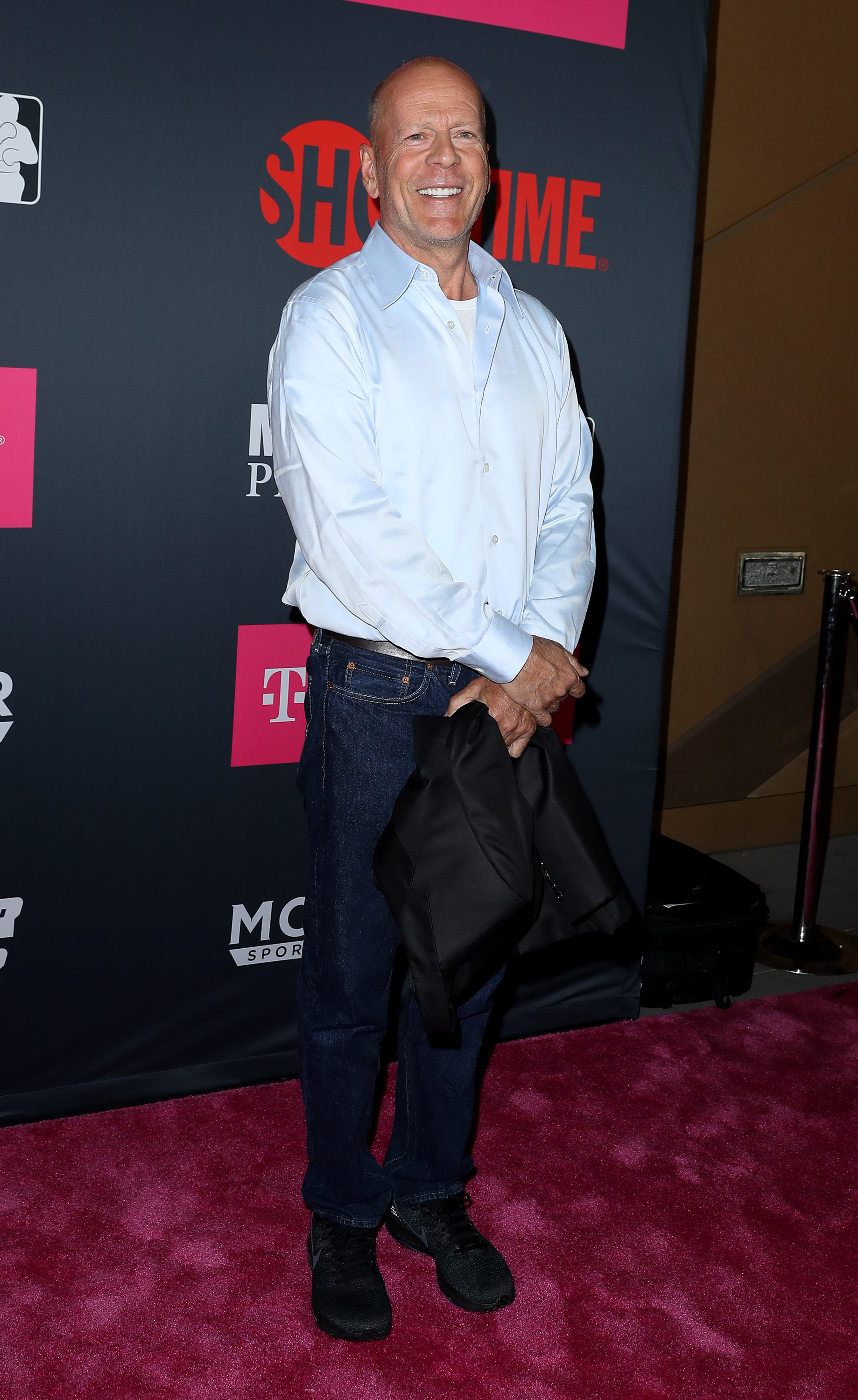 Bruce Willis arrives at the Mayweather vs. McGregor Pre Event VIP Party Red Carpet at T Mobile Arena in Las Vegas on Aug. 26, 2017.