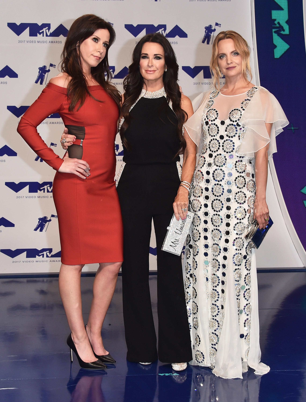 Jennifer Bartels, Kyle Richards and Mena Suvari attend the MTV Video Music Awards in Los Angeles on Aug. 27, 2017.