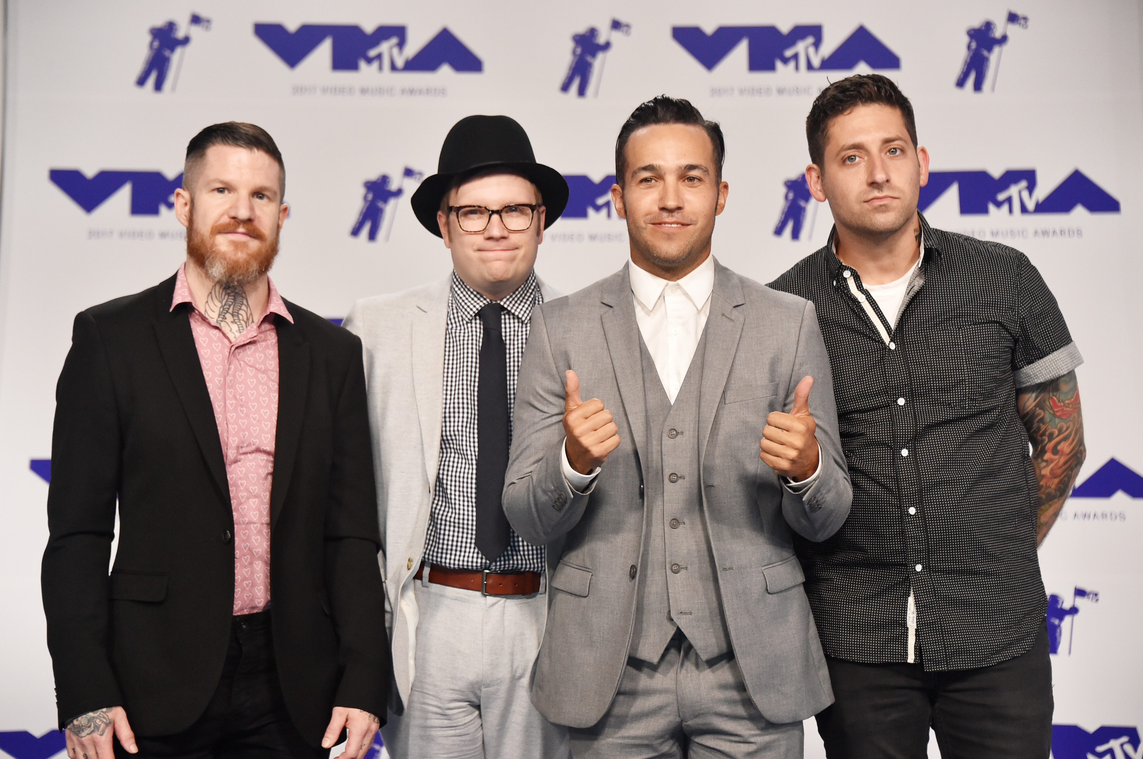 Andy Hurley, Patrick Stump, Pete Wentz and Joe Trohman of Fall Out Boy attend the MTV Video Music Awards in Los Angeles on Aug. 27, 2017.