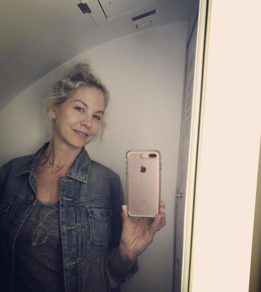 """""""I've never taken one of those obnoxious airplane bathroom selfies. There's a first for everything. ✈️""""   Jenna Elfman, who posted this makeup free selfie to Instagram while in the air on July 27, 2017"""