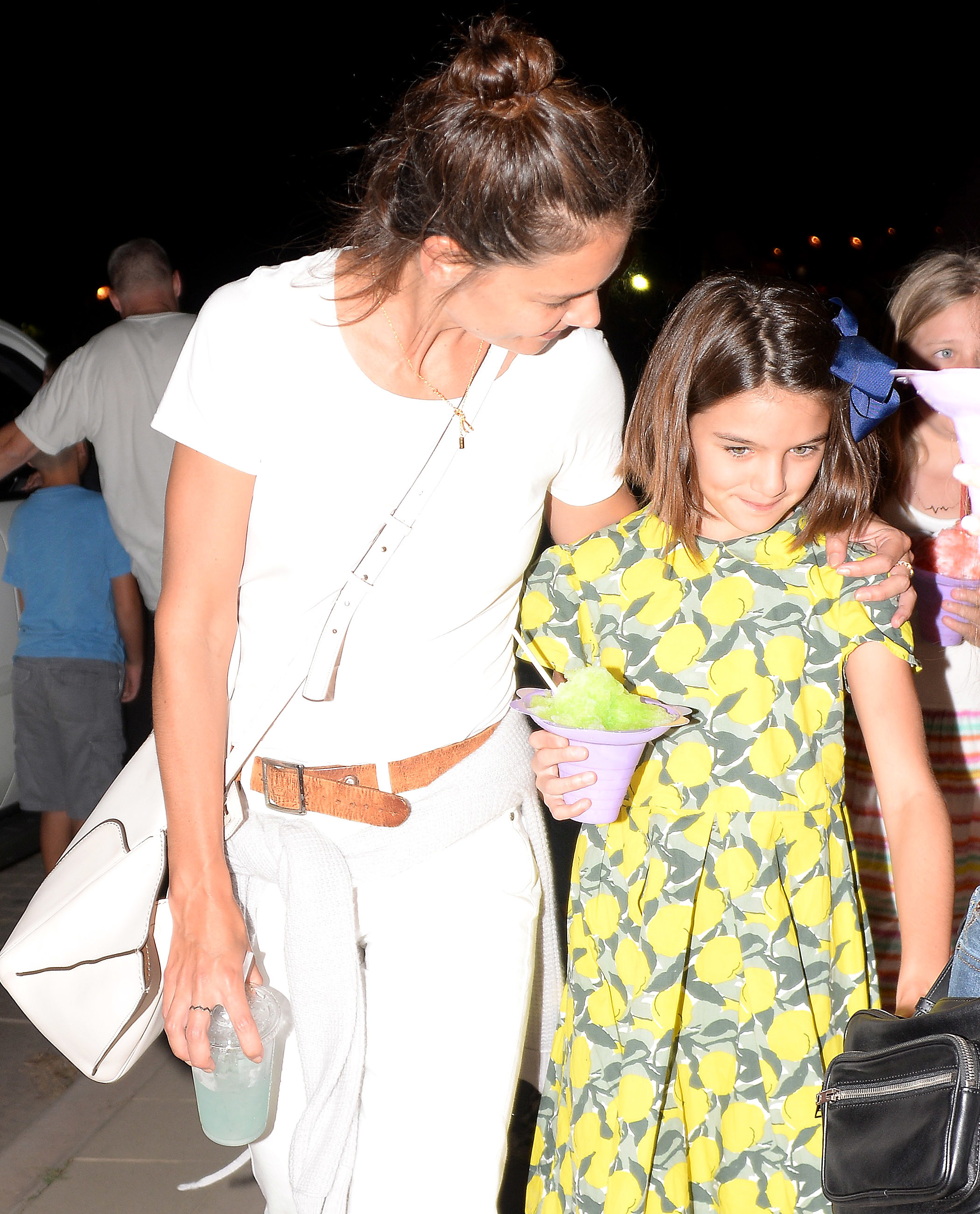 Katie Holmes and Suri Cruise walk around the 36th Annual Malibu Chili Cook Off in Los Angeles, Calif., on Sept. 3, 2017.