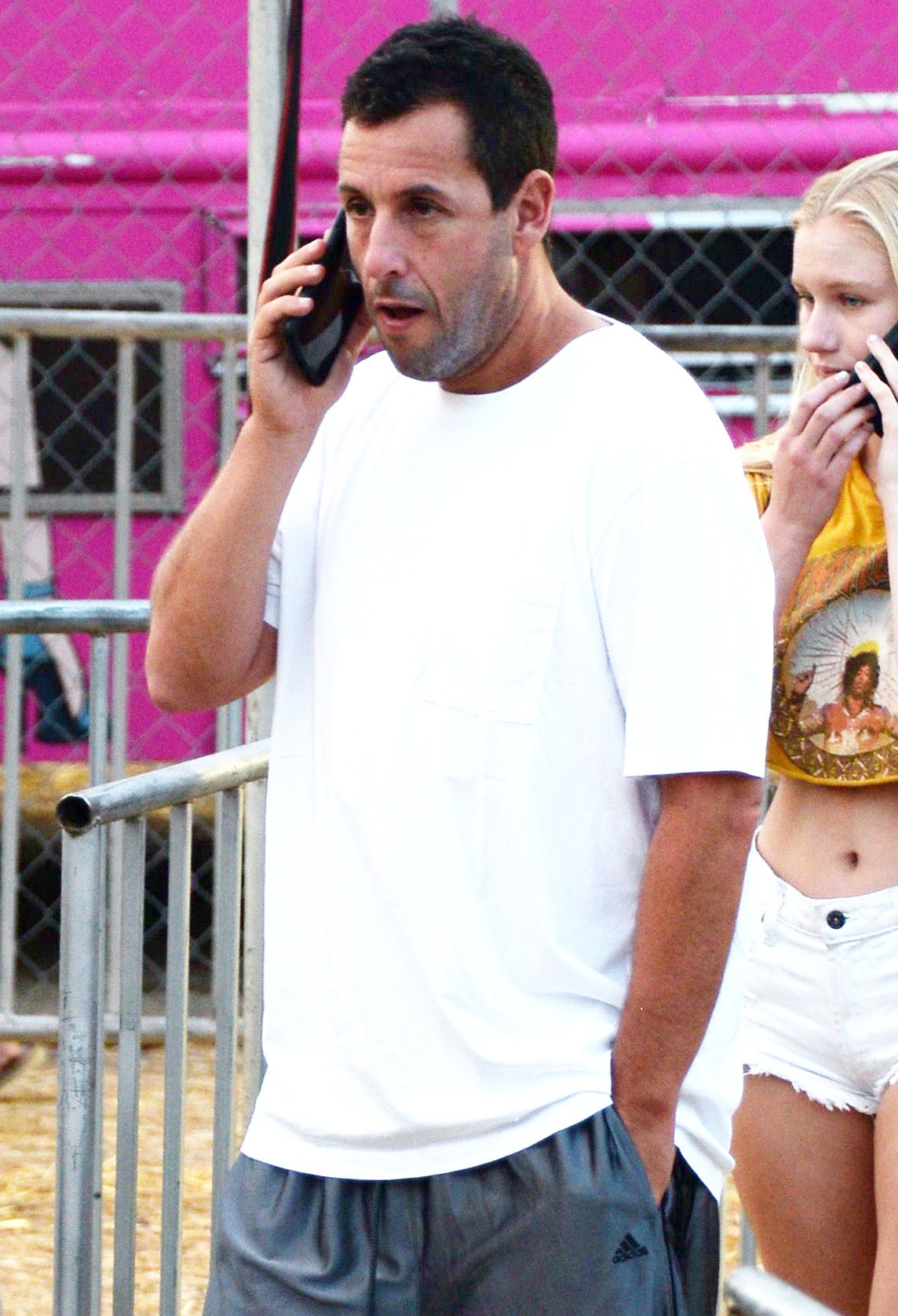 Adam Sandler talked on the phone while at the 36th Annual Malibu Chili Cook Off in Los Angeles, Calif., on Sept. 3, 2017.