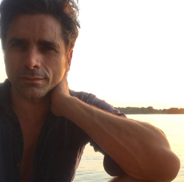 """""""#happybrainfartday #happylabordayweekend""""   John Stamos, who posted this photo on Instagram on Sept. 4, 2017."""