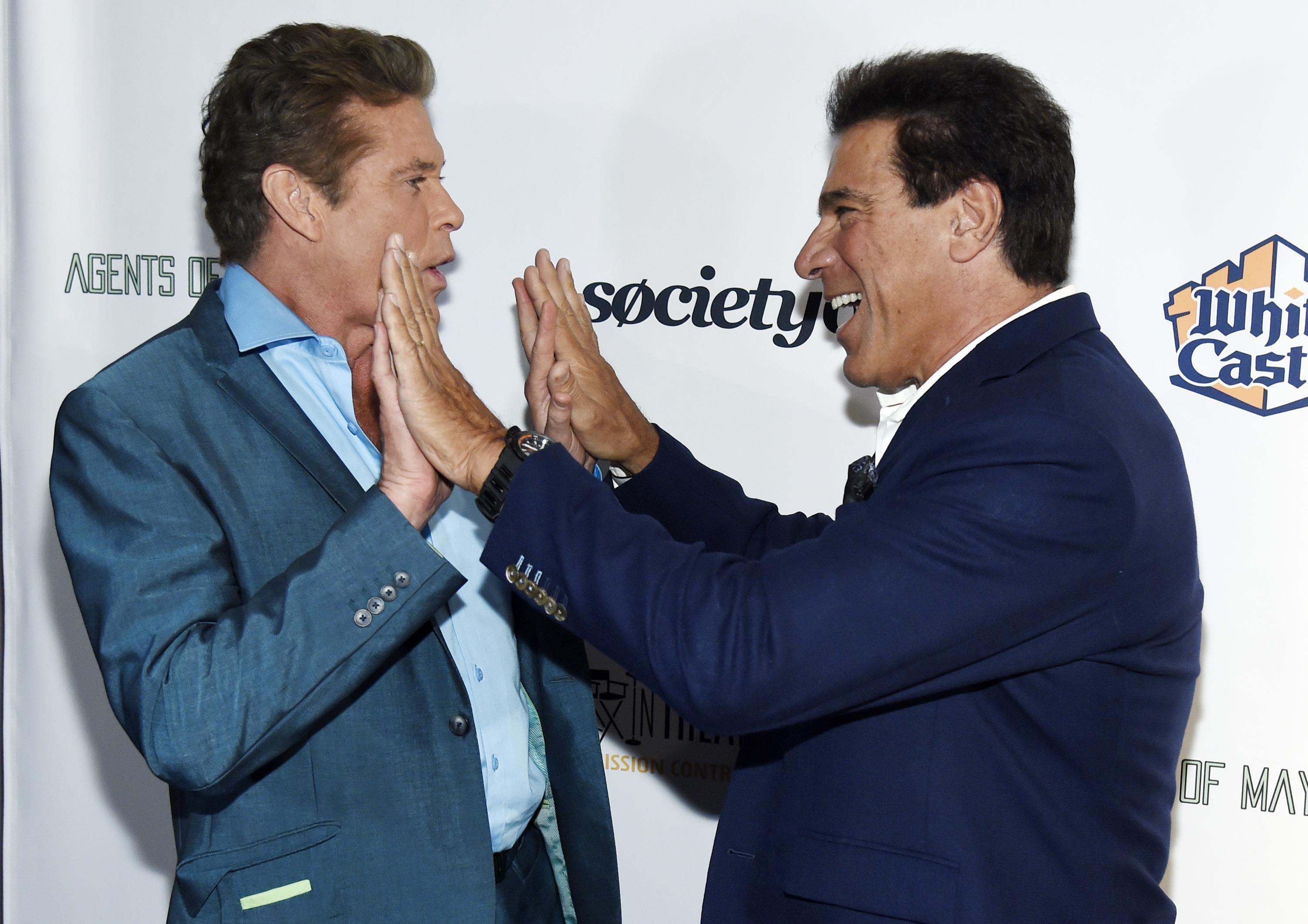 "David Hasselhoff and Lou Ferrigno greet each other on the red carpet at the ""Extraordinary: Stan Lee"" tribute in Beverly Hills on Aug. 22, 2017."
