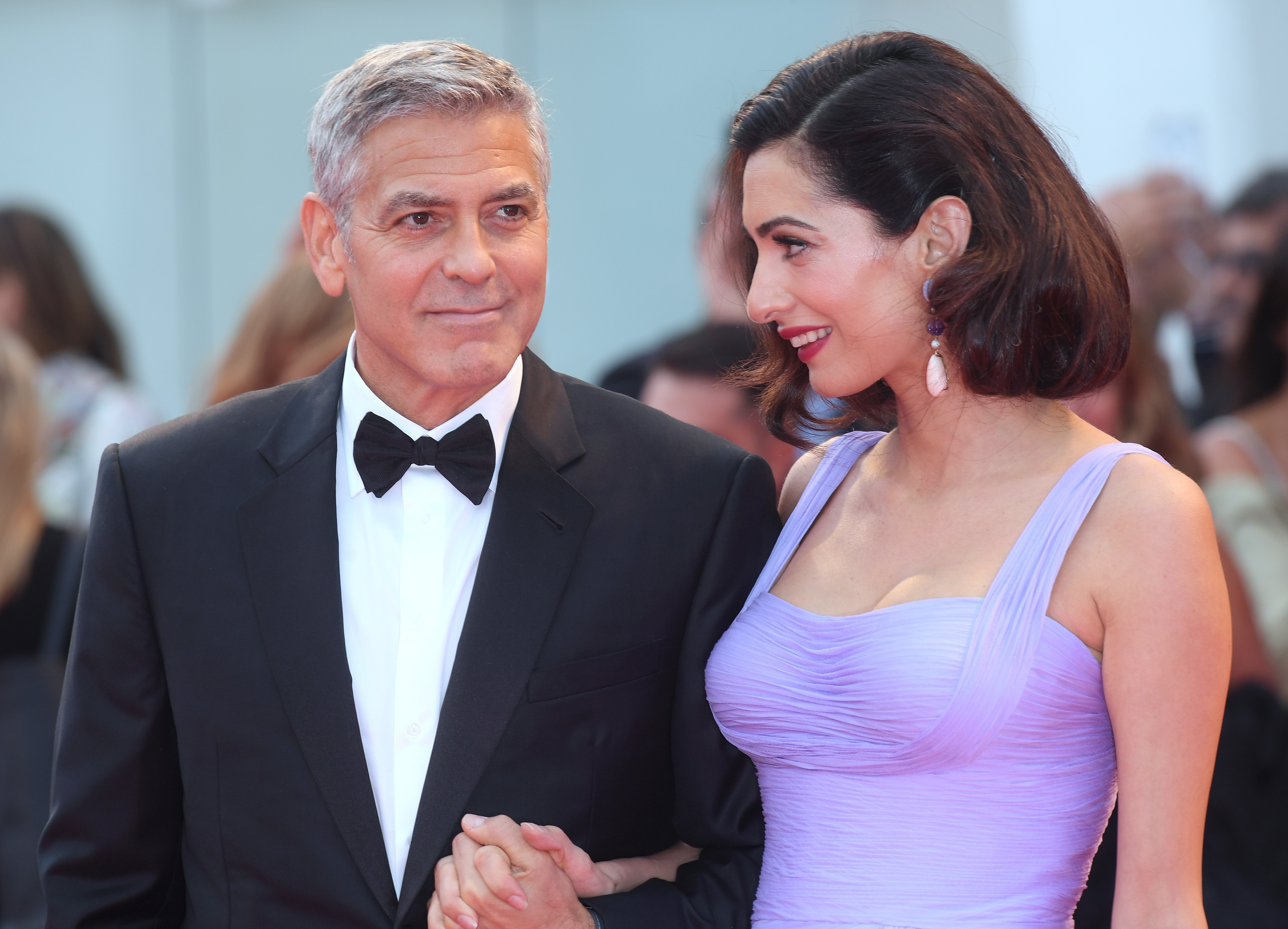 """Amal Clooney and George Clooney attend the """"Suburbicon"""" premiere at the 74th Venice International Film Festival in Venice, Italy on Sept. 2, 2017."""