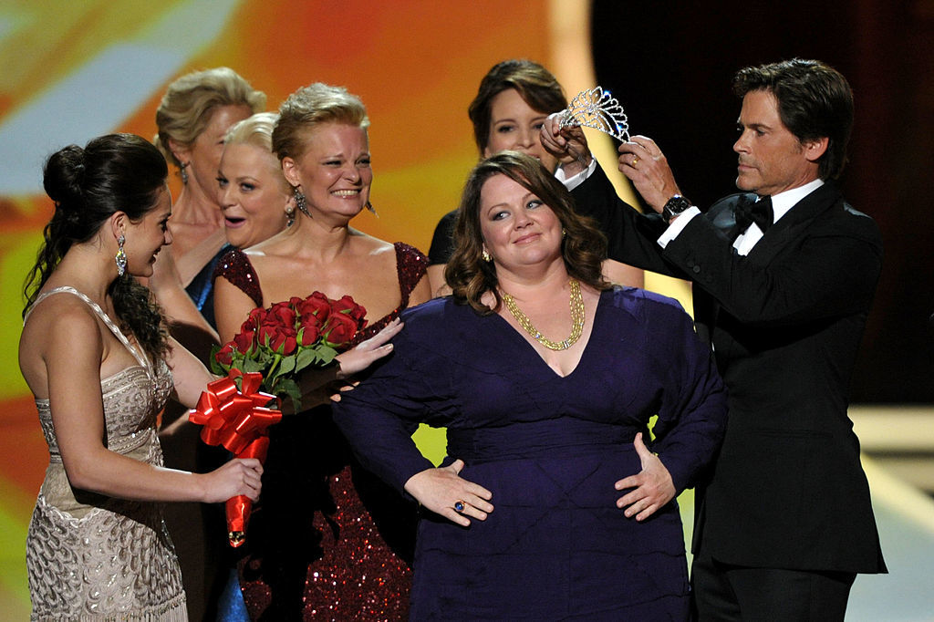 Actresses Edie Falco, Martha Plimpton, Tina Fey, Amy Poehler and actor Rob Lowe present Melissa McCarthy with her Emmy award during the 63rd Primetime Emmy Awards at the Nokia Theatre L.A. Live in Los Angeles on Sept. 18, 2011.